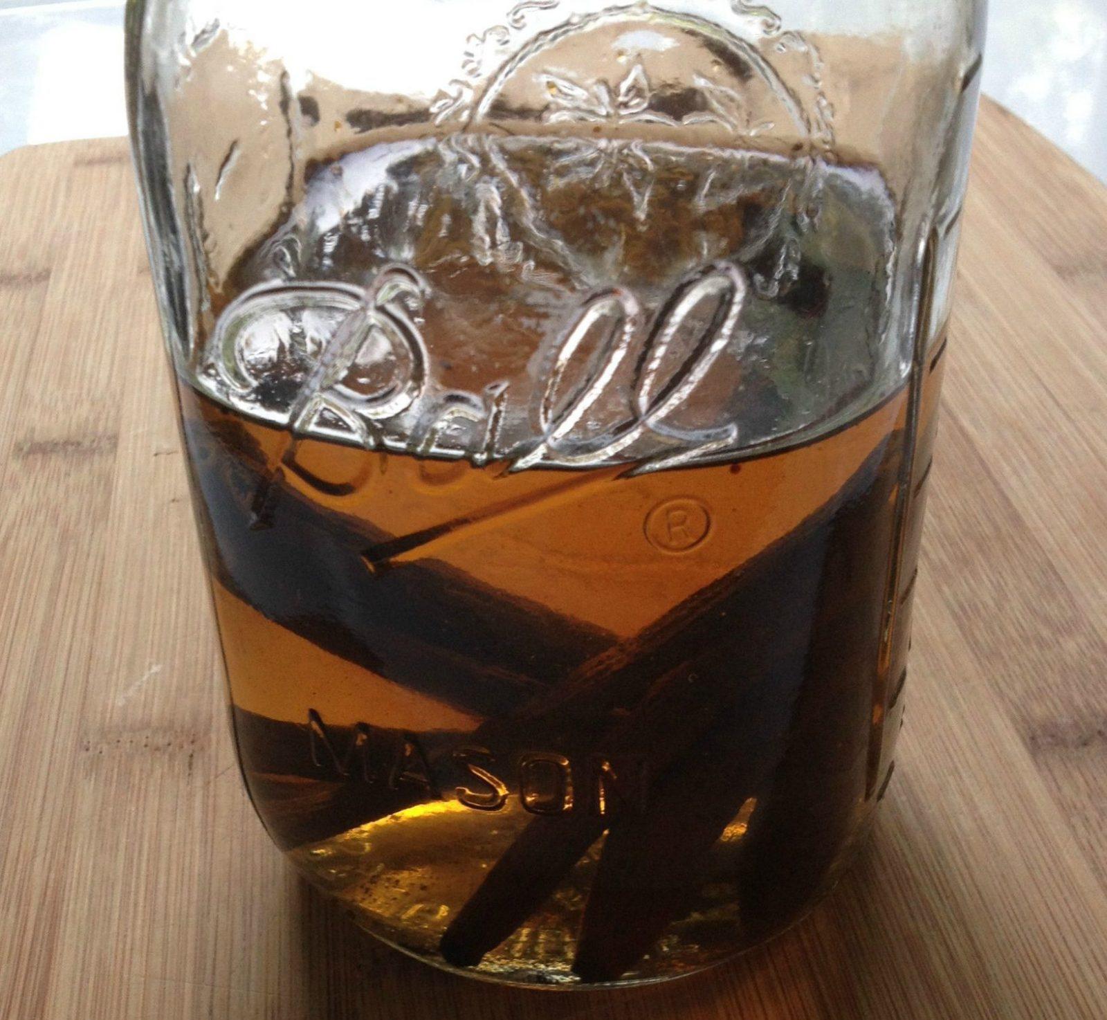 vanilla beans soaking in a quart mason jar