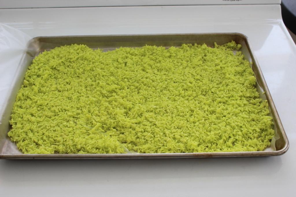 green rice on baking sheet