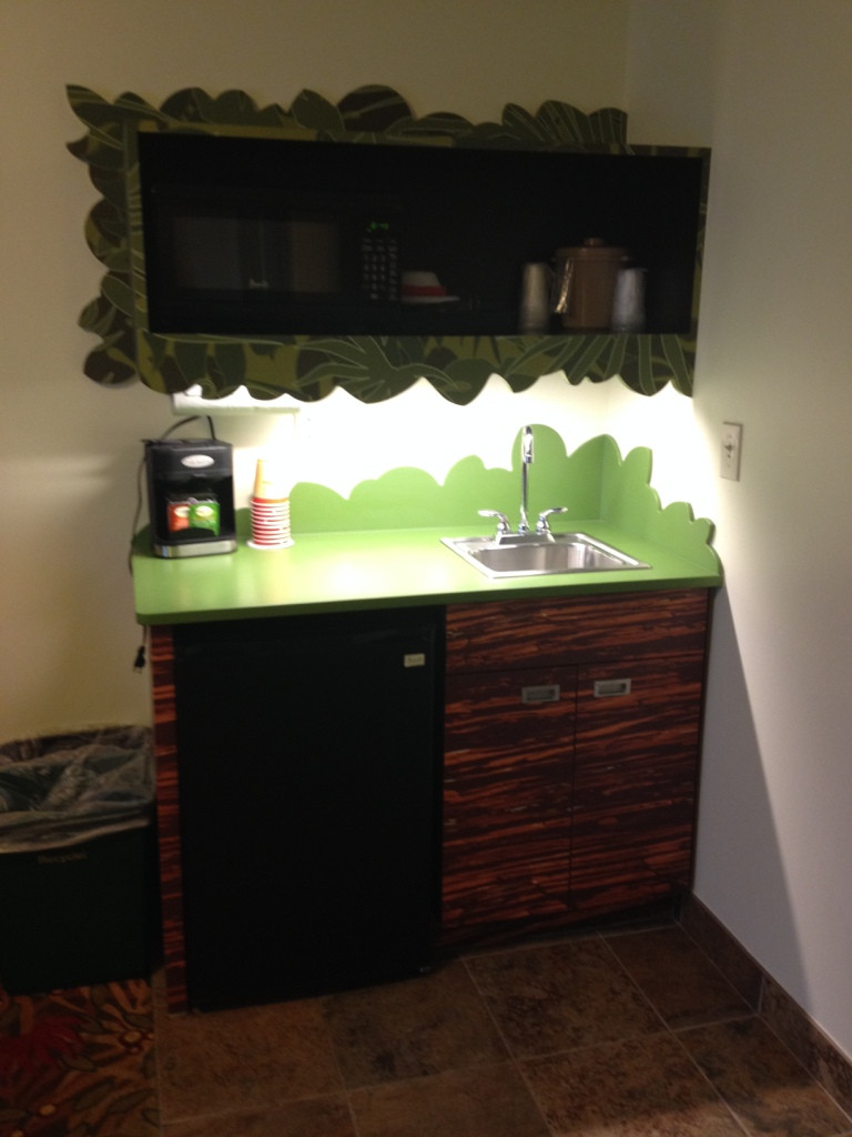 kitchenette in art of animation lion king themed room
