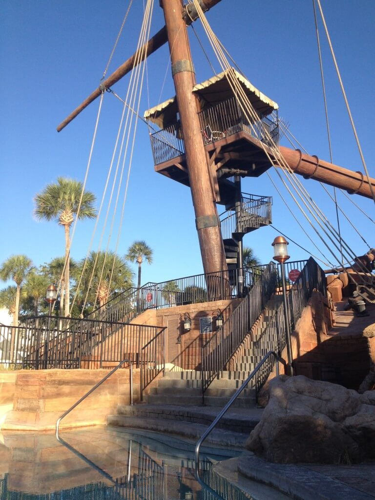 kiddie pool and water slide inside the pirate ship