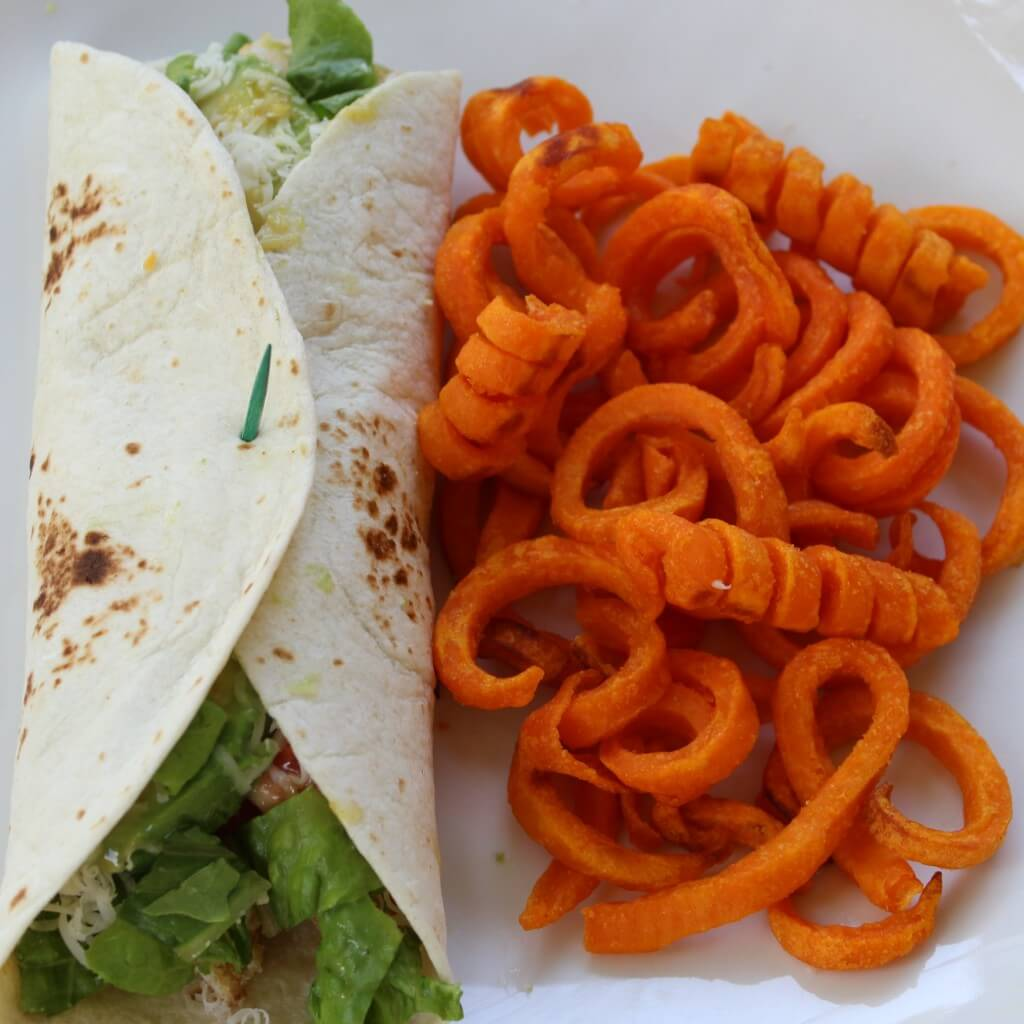 wrap served with sweet potato fries