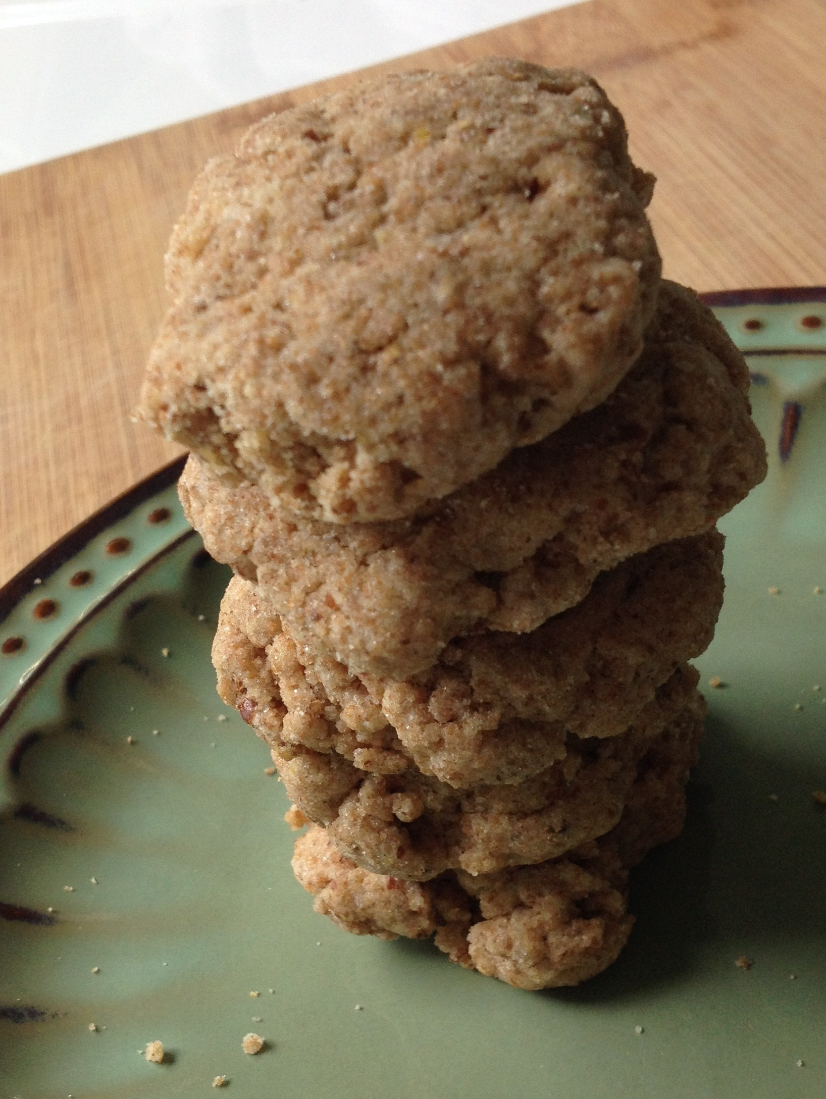 whole wheat flaxseed cookies stacked up on a plate