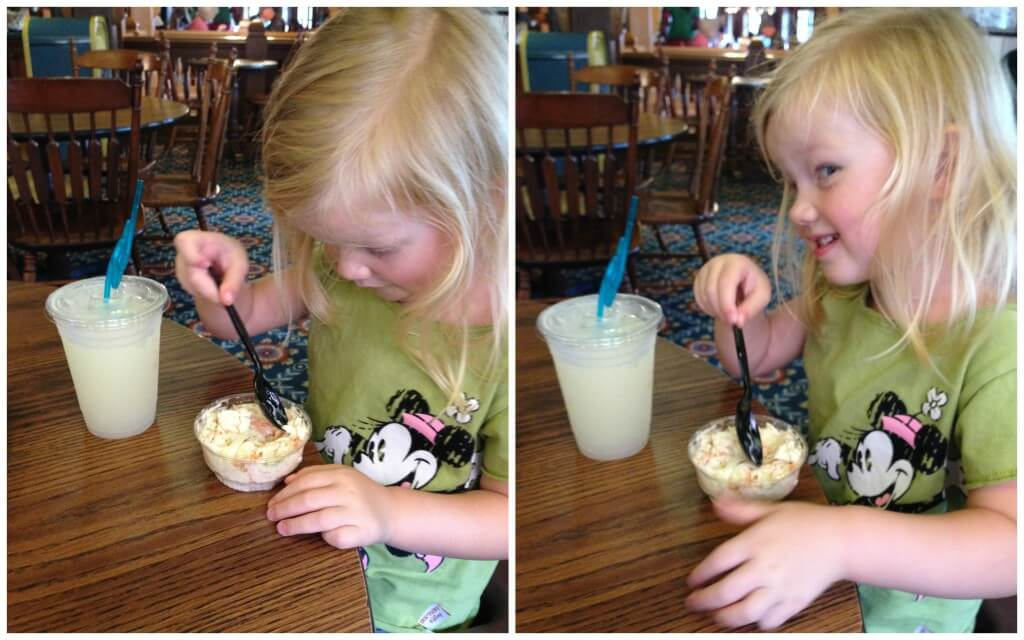 little girl enjoying a lemonade slush and coleslaw