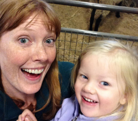 mom and daughter selfie by the sheep