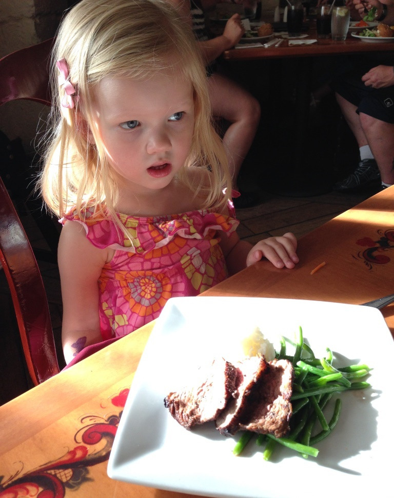 little girl eating her lunch at Akershus