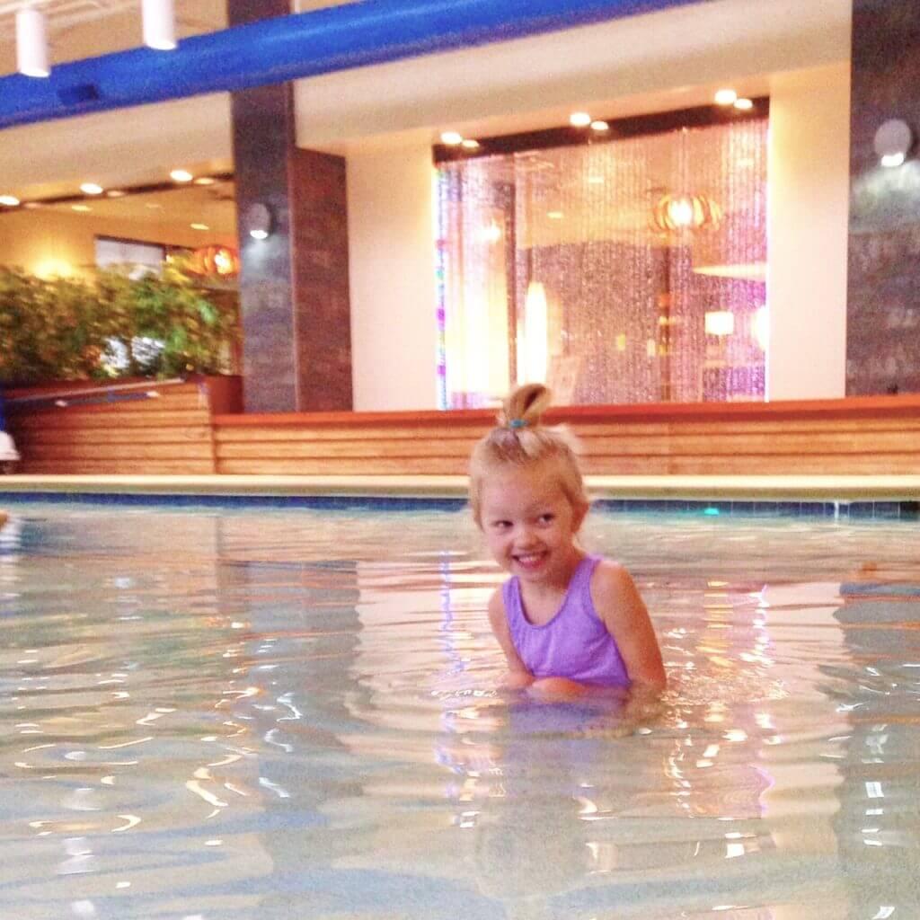 little girl enjoying the saltwater pool