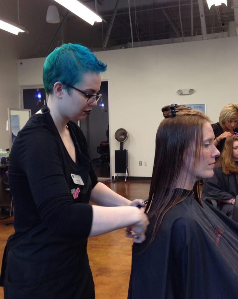 woman receiving haircut