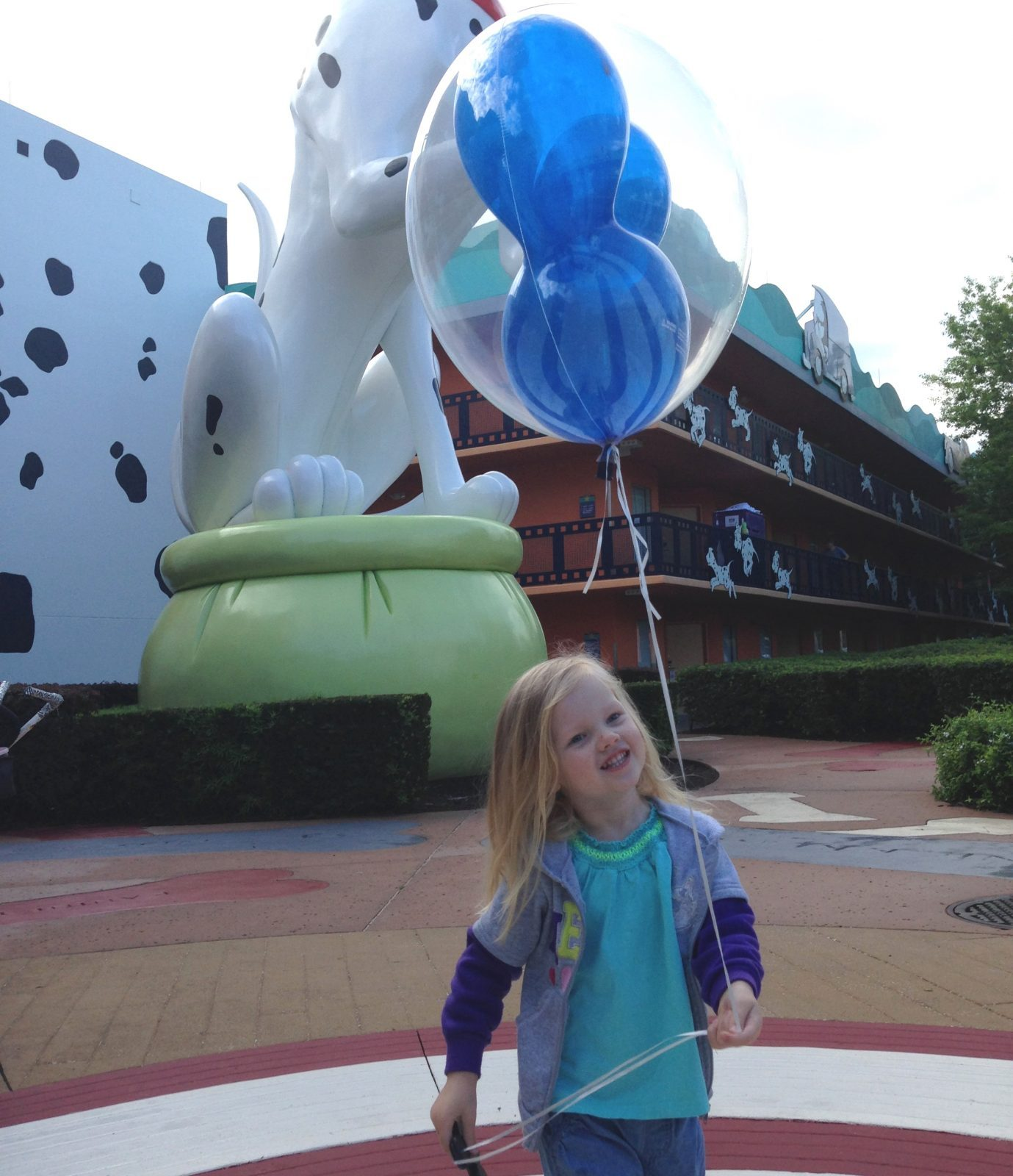 little girl with a mickey balloon