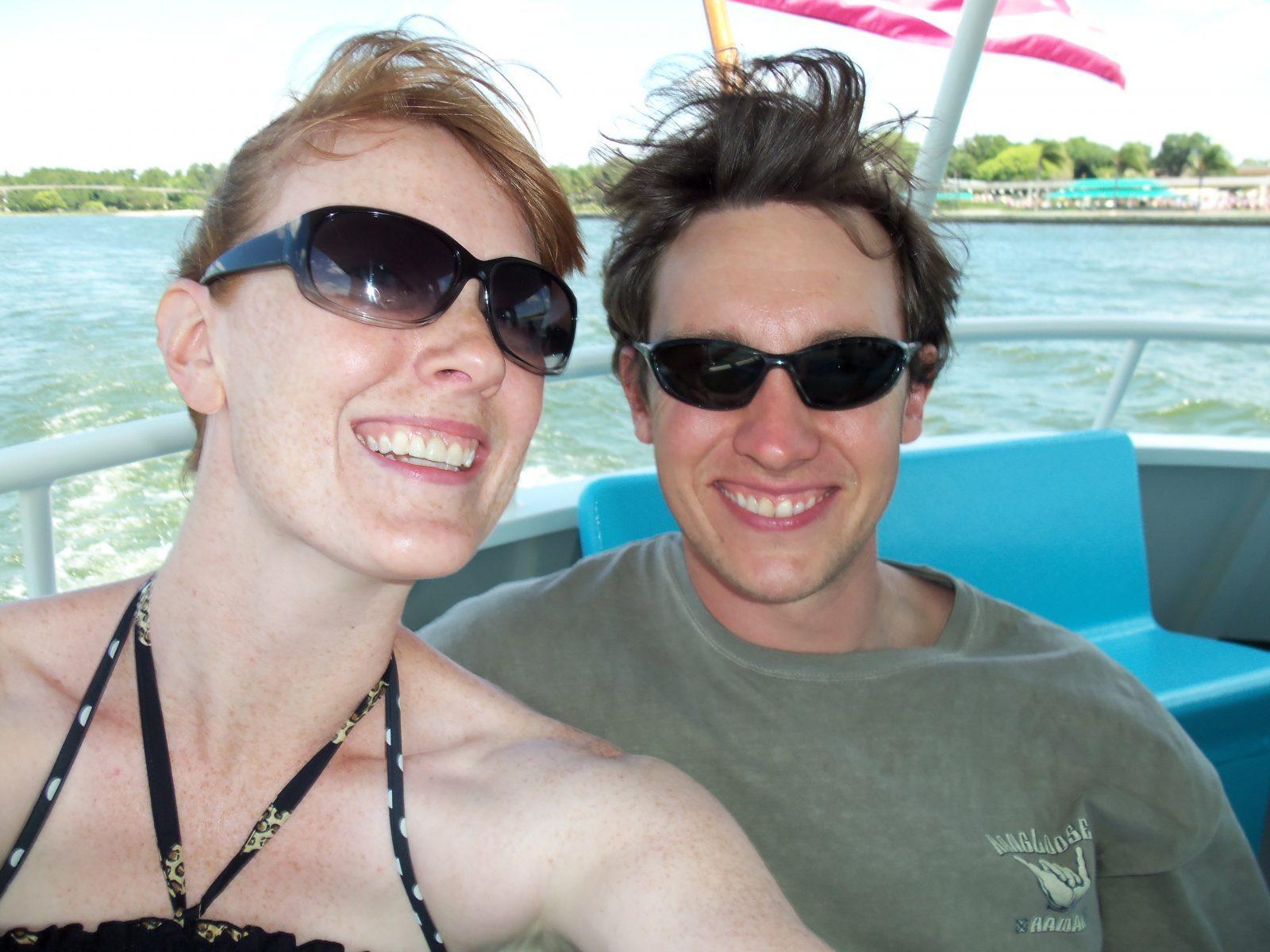 couple enjoying a boat ride at disney