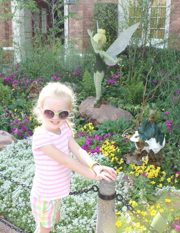 epcot flower and garden festival with kids - girl with tinkerbell topiary