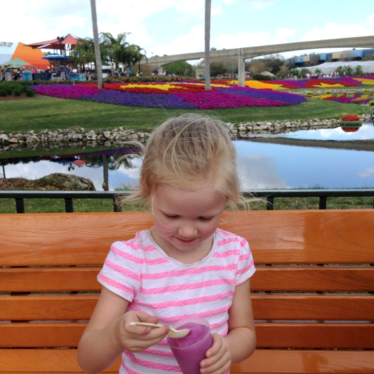 girl eating violet lemonade