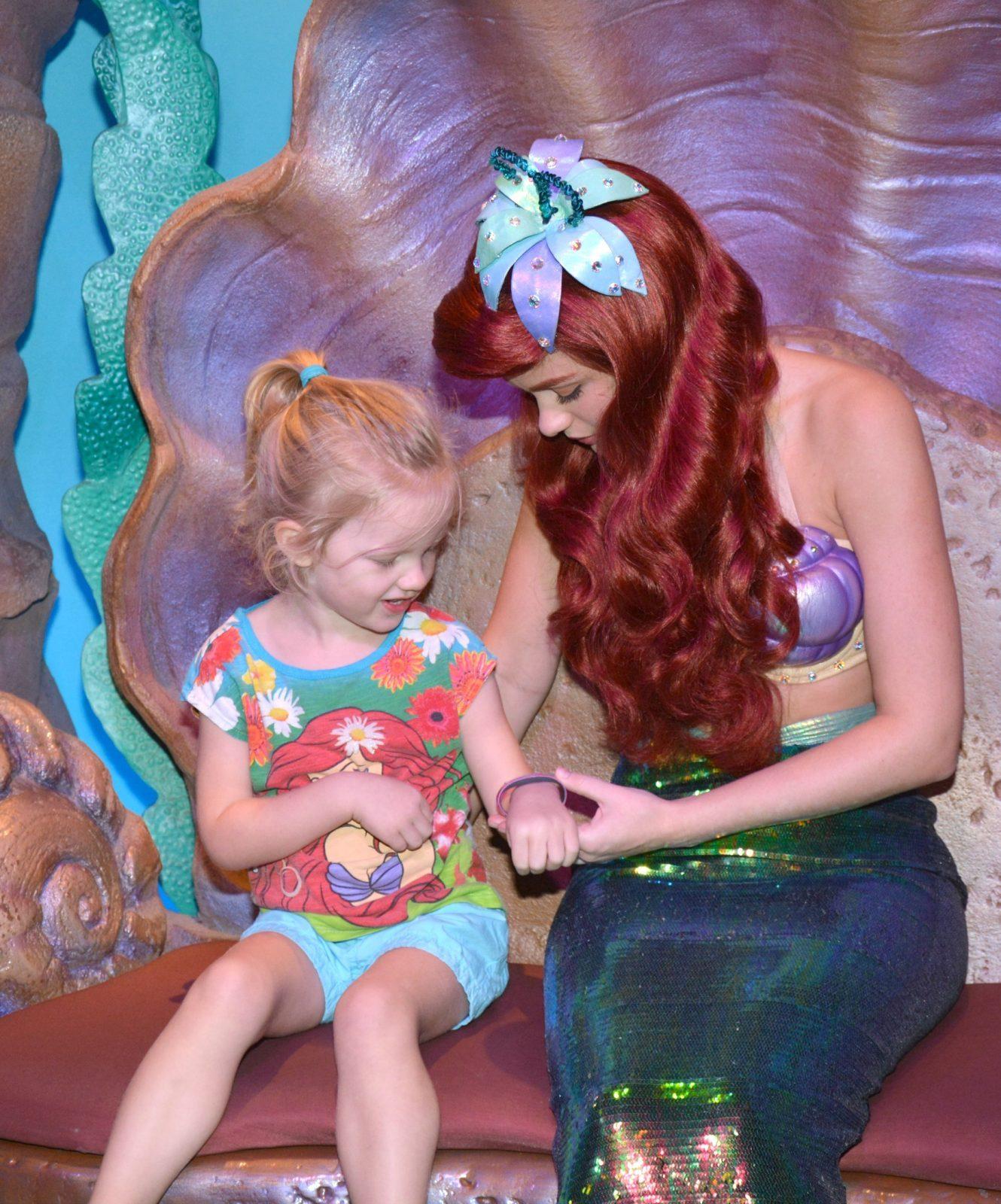 little girl meeting the little mermaid
