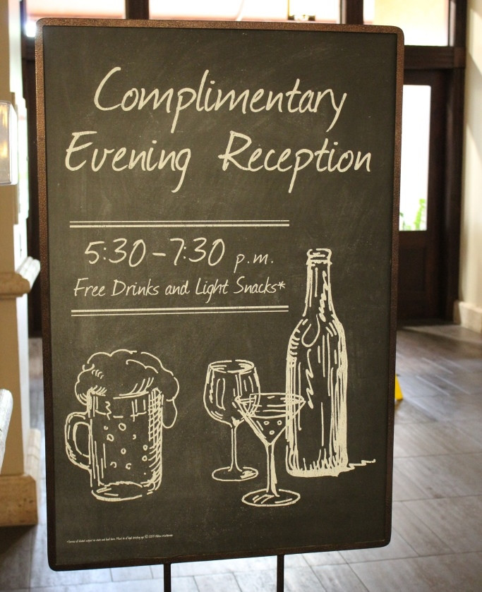 complimentary evening reception sign