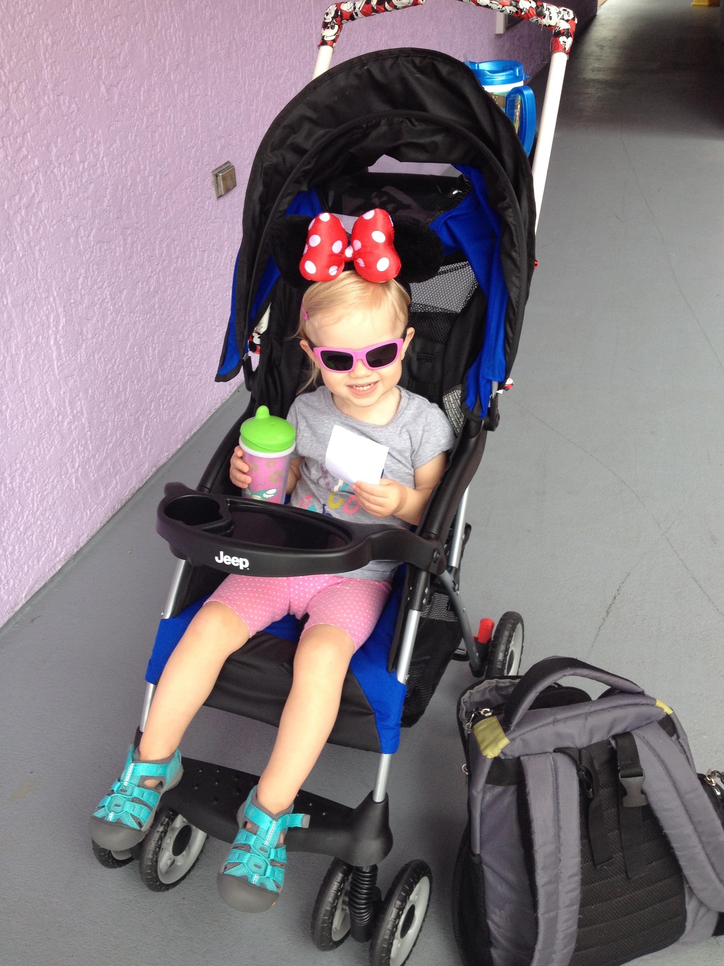 little girl in a stroller