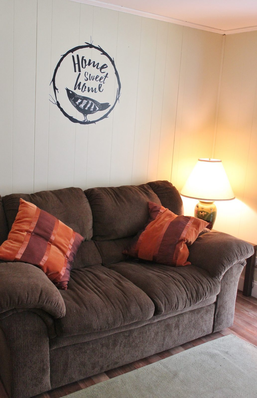 home sweet home decal over love seat