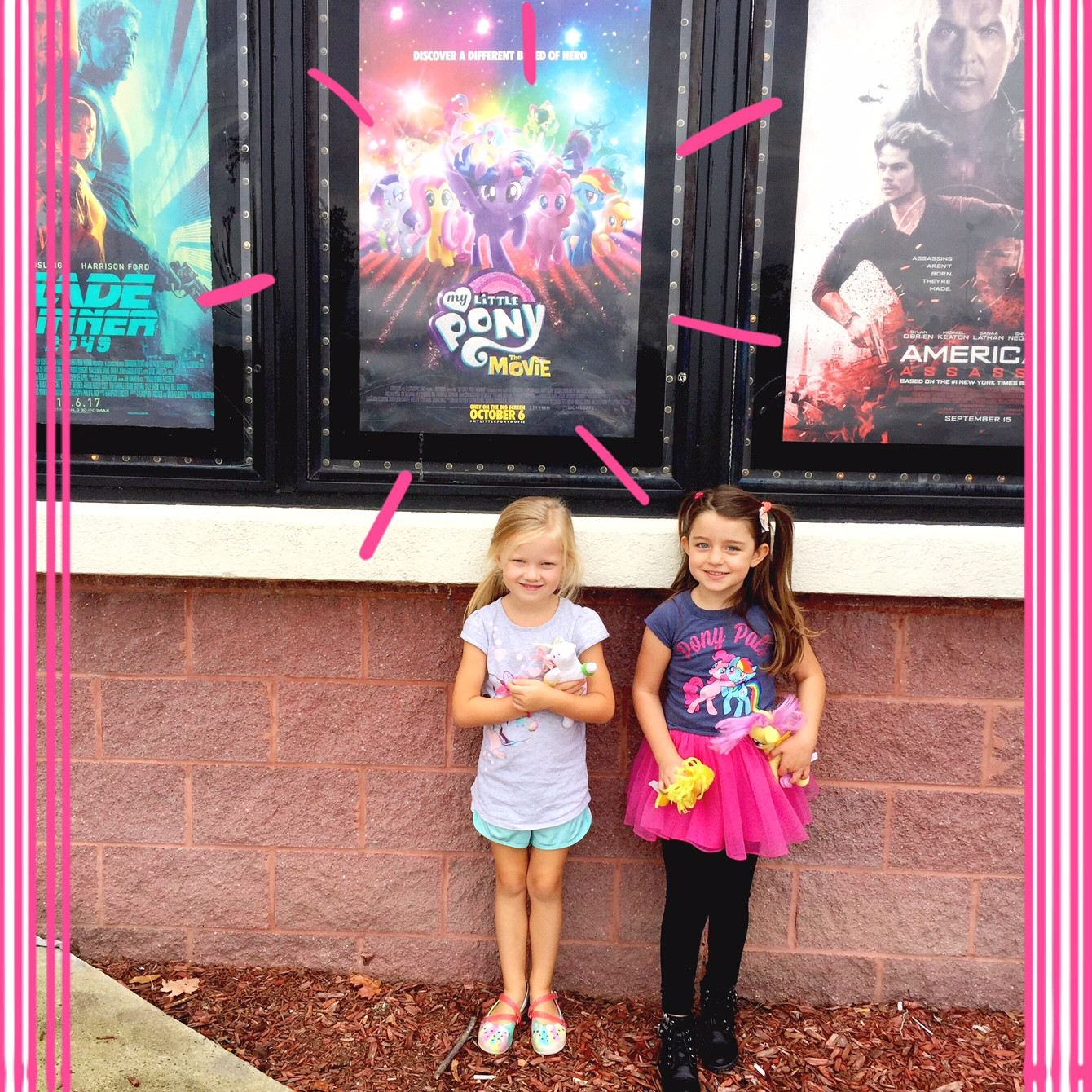 little girls in front of my little pony movie poster