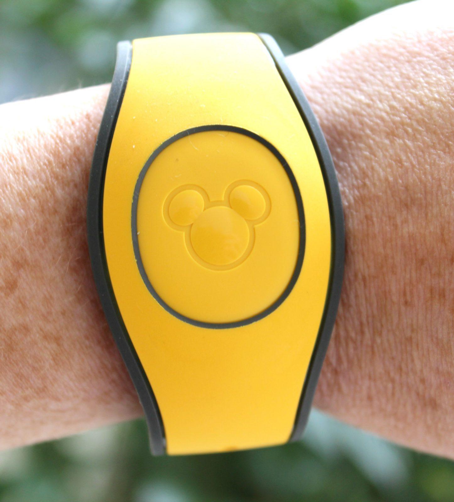 Yellow Magic Band on a wrist
