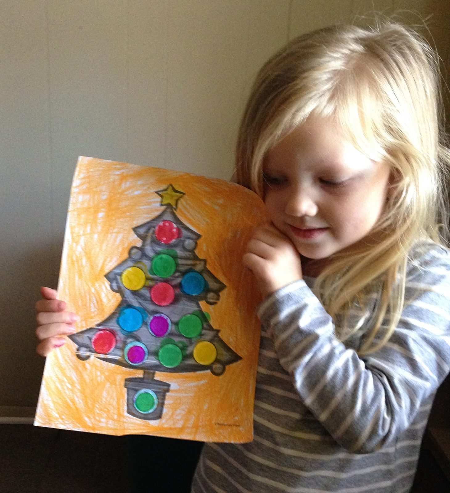 little girl holding a christmas tree coloring page