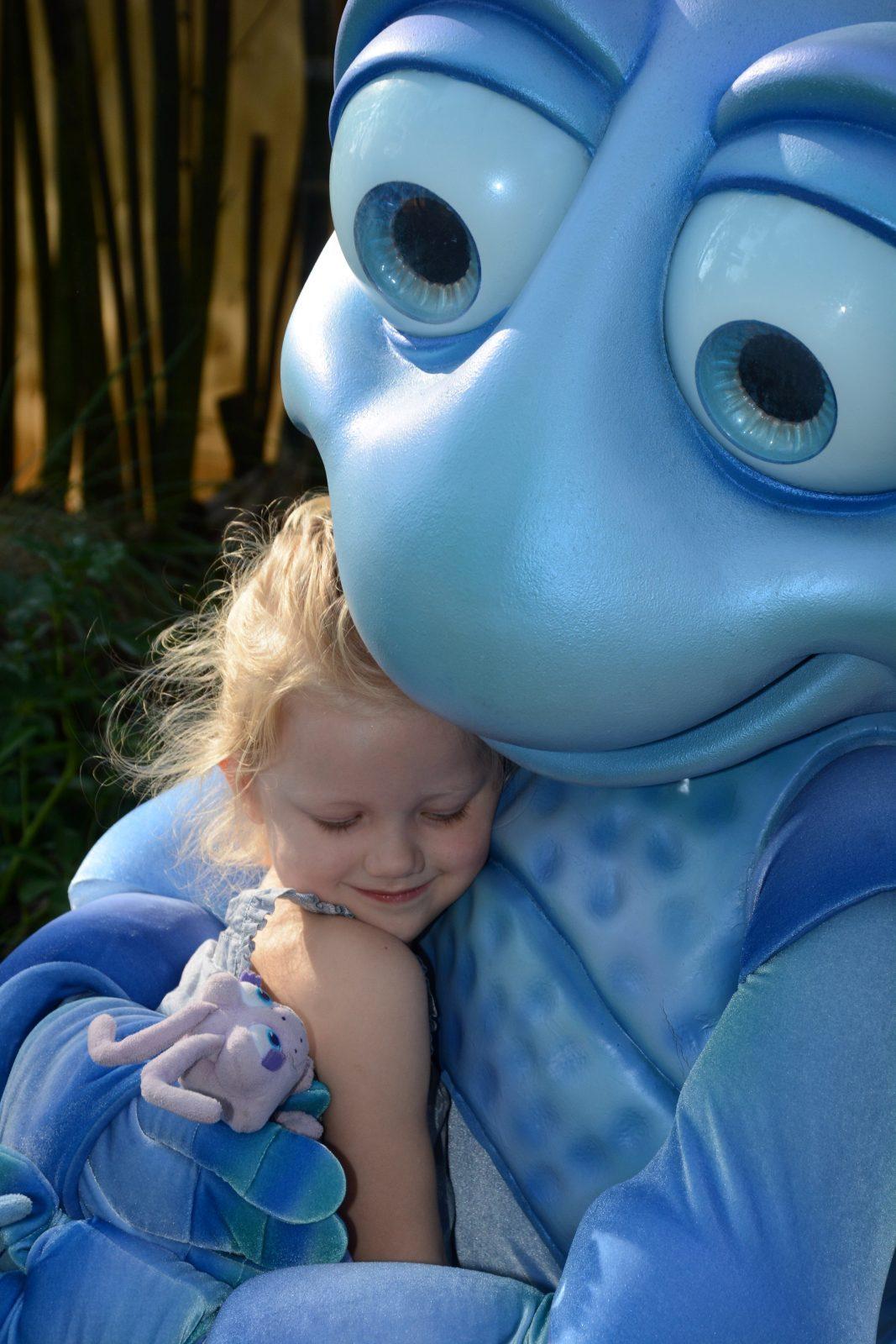 Disney character, Flick, hugging little girl