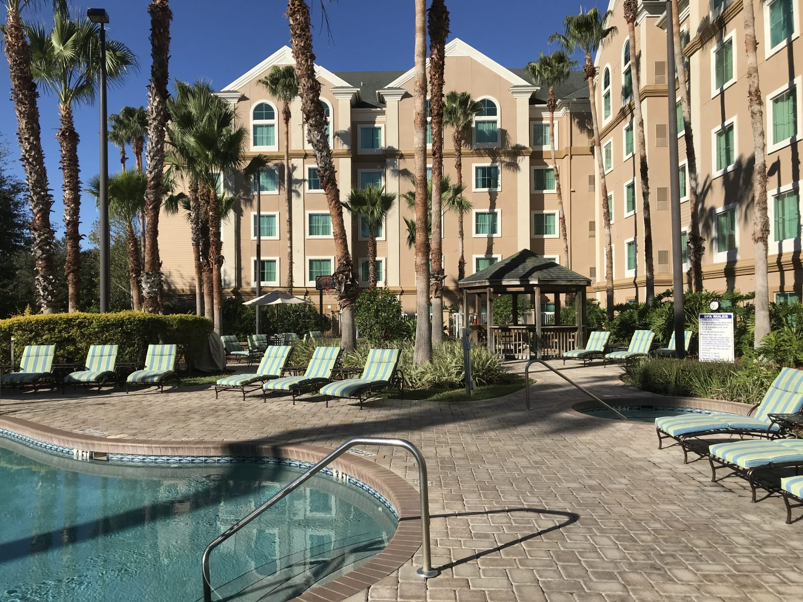 How to get a one-bedroom suite near Disney World from $75/night. Resort review of an affordable off-property Disney World hotel. #disneyworld #budgettravel #familytravel