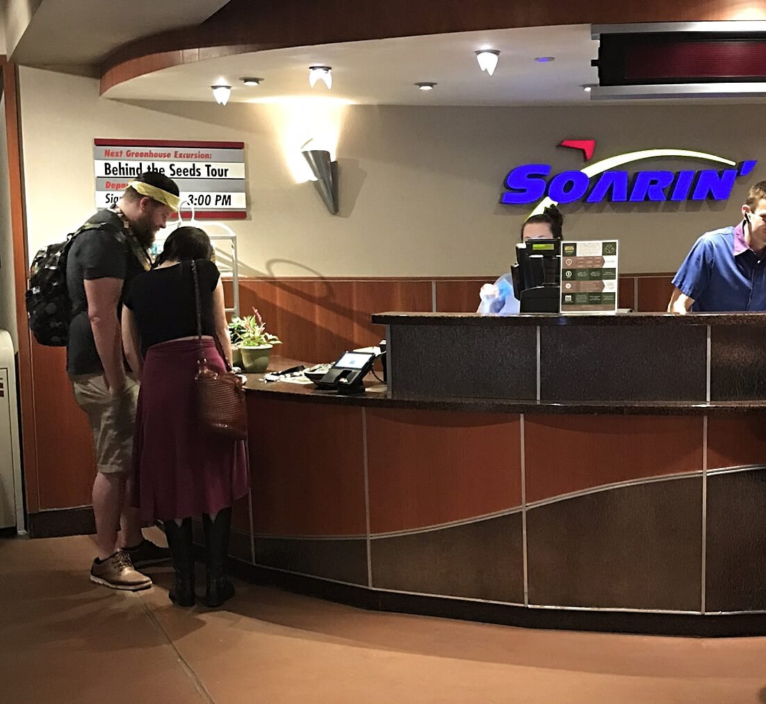 a couple reviewing information at the soarin' desk