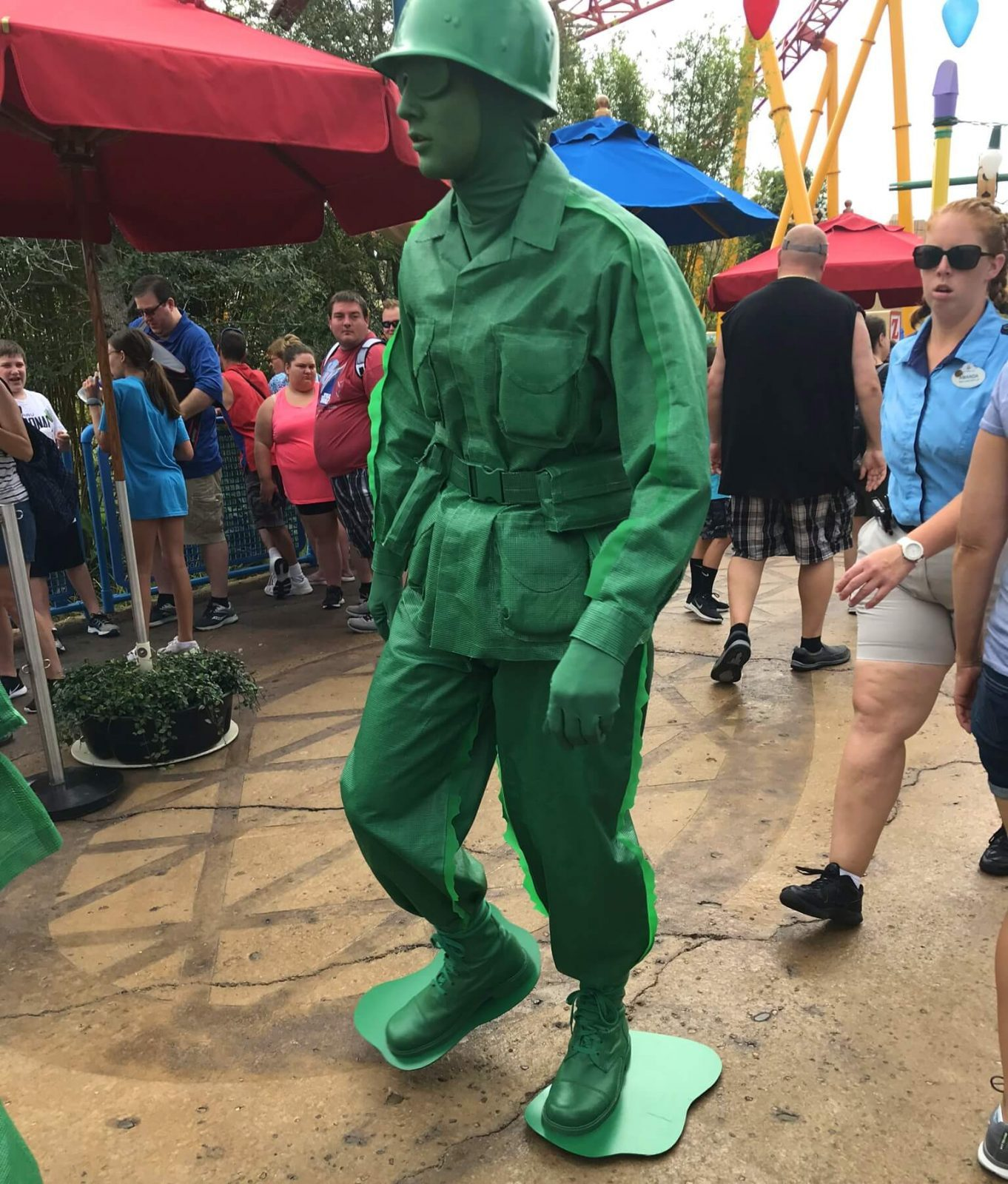 disney character green army man walking around toy story land