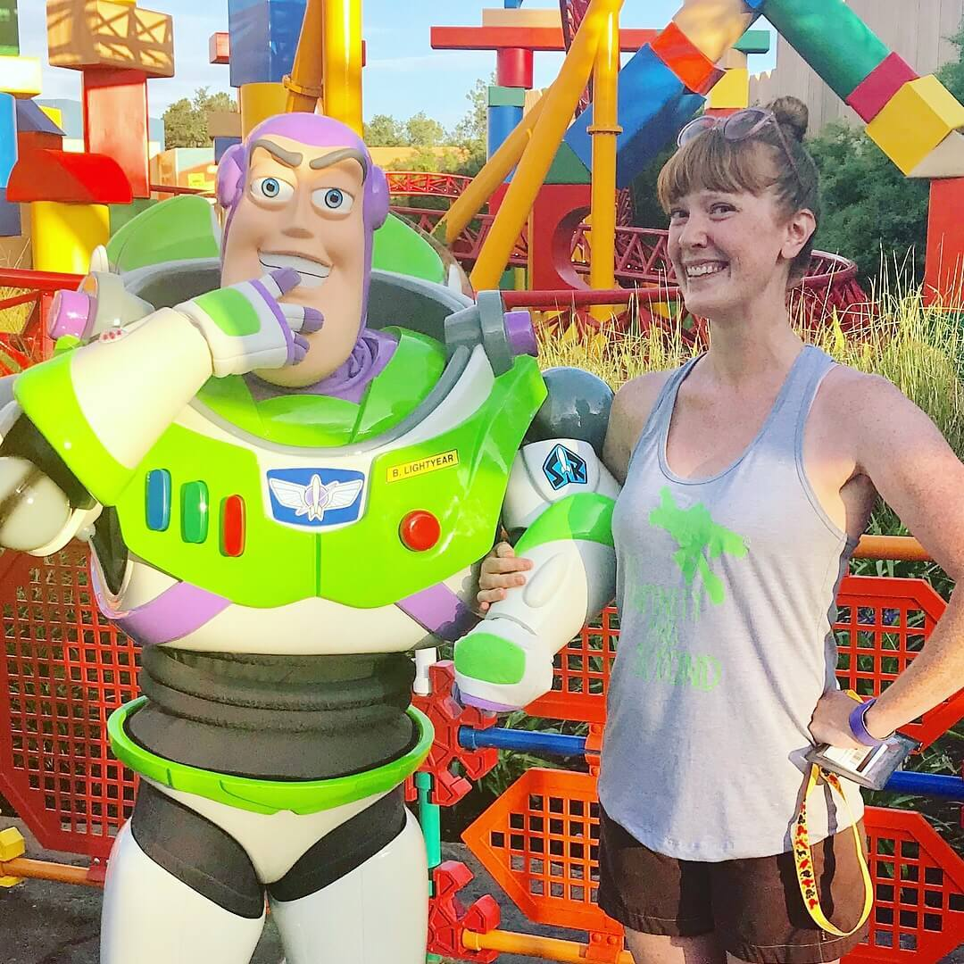 woman posing with disney character buzz light year