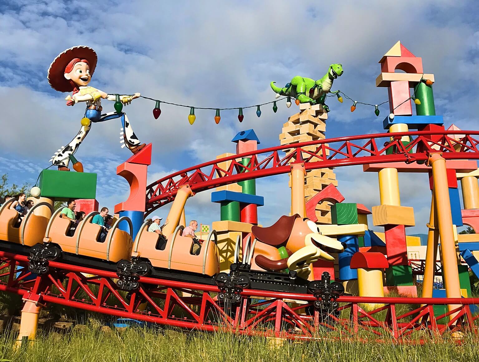 toy story land, cowgirl Jessie and building block statues and slinky dog dash ride