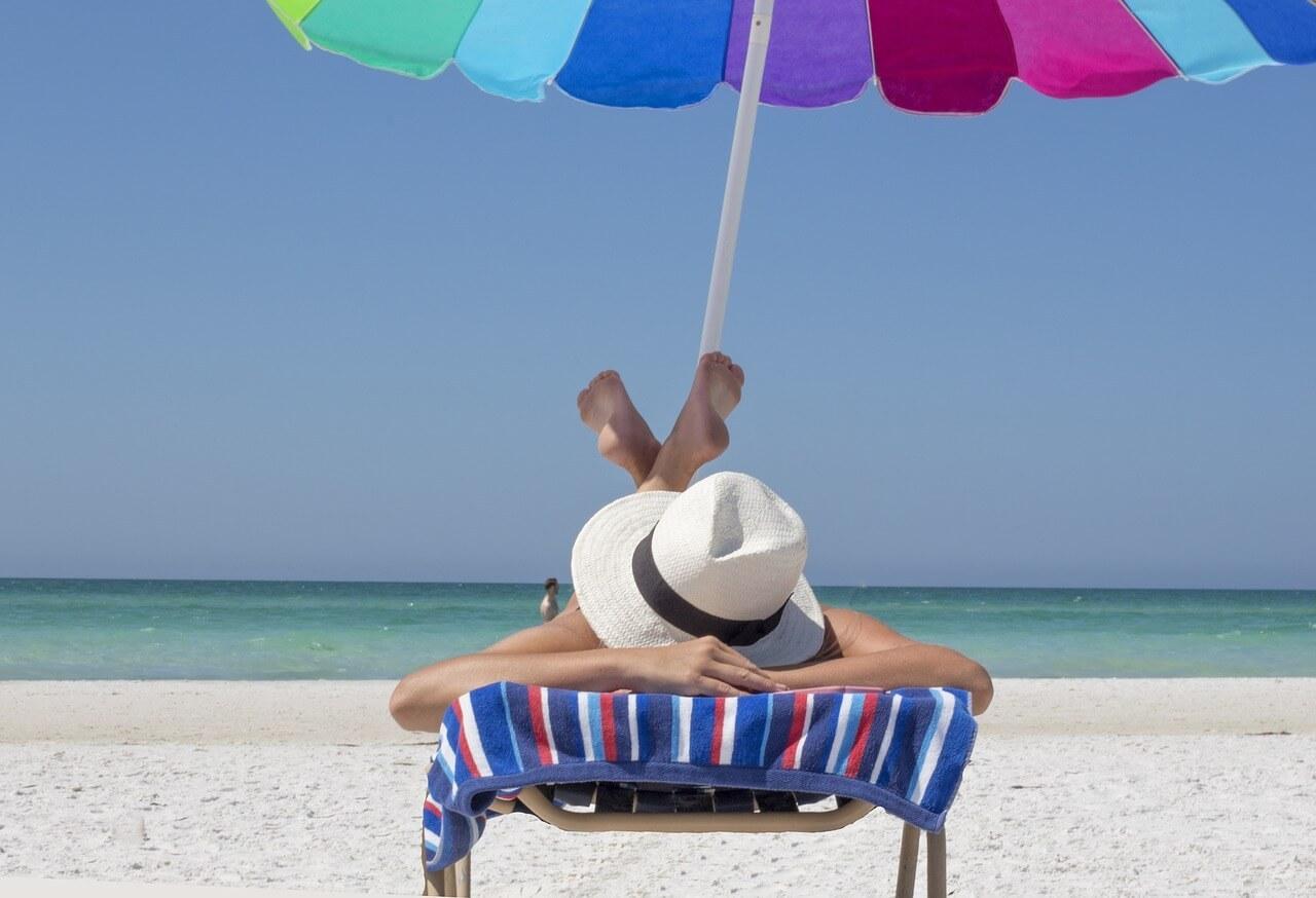 woman on a beach chair at the beach
