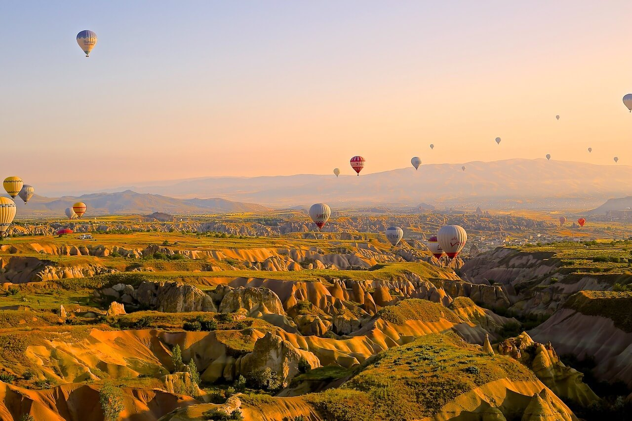 hot air balloons flying over Turkey