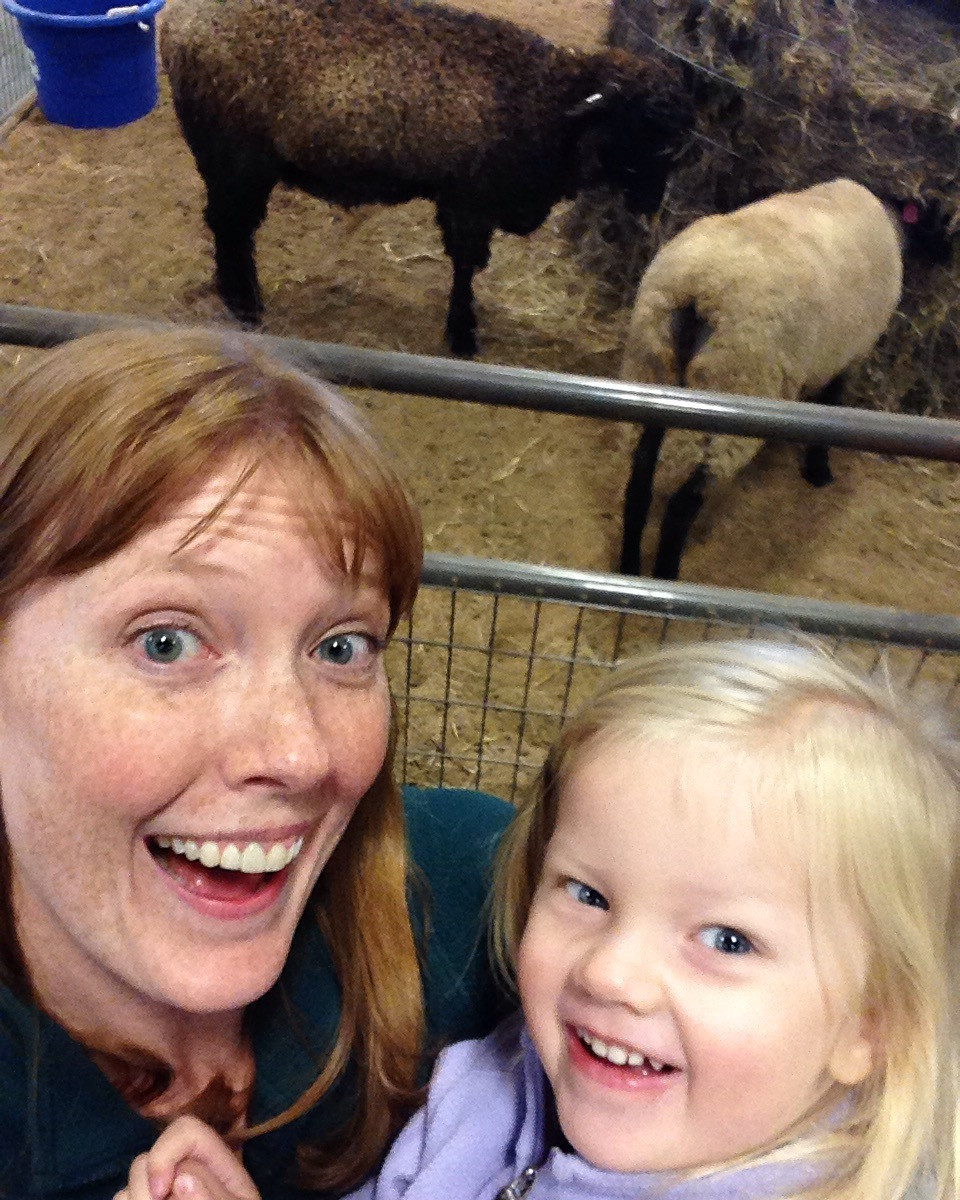 mother daughter selfie by the sheep