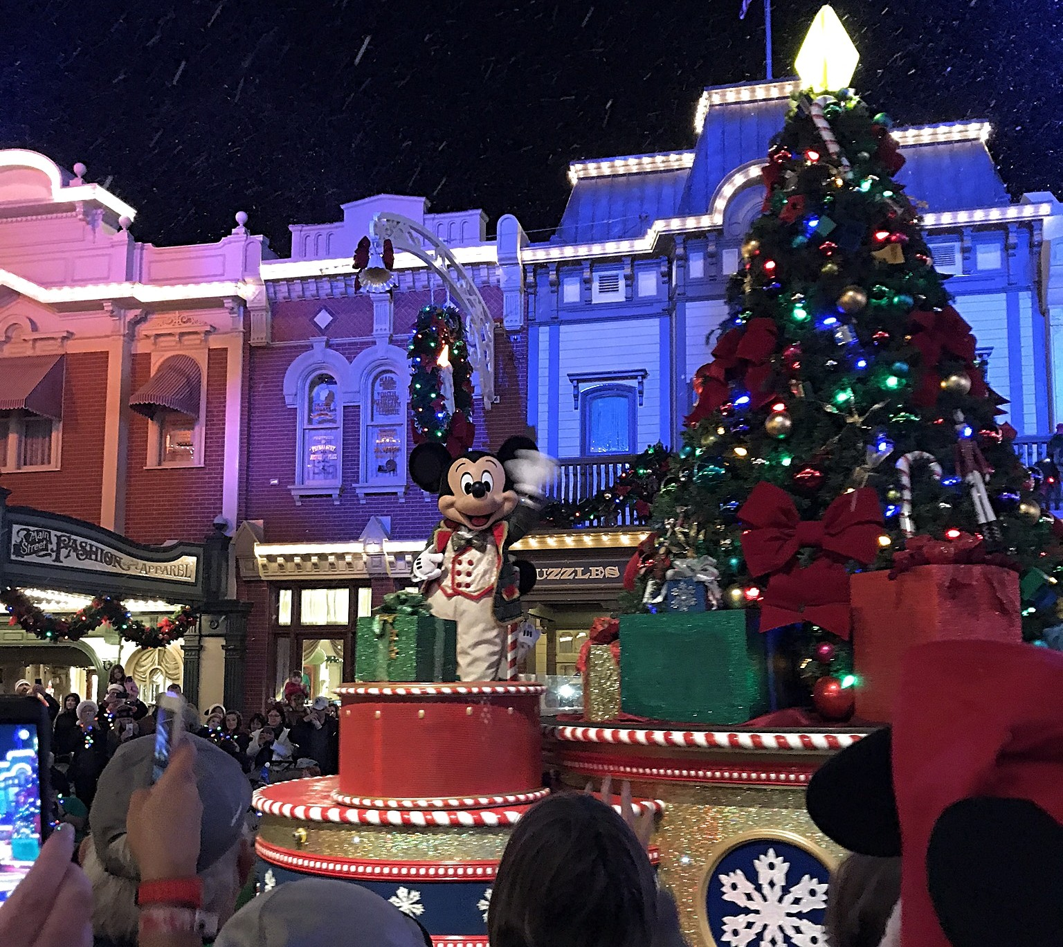 Mickey on a christmas float during a parade