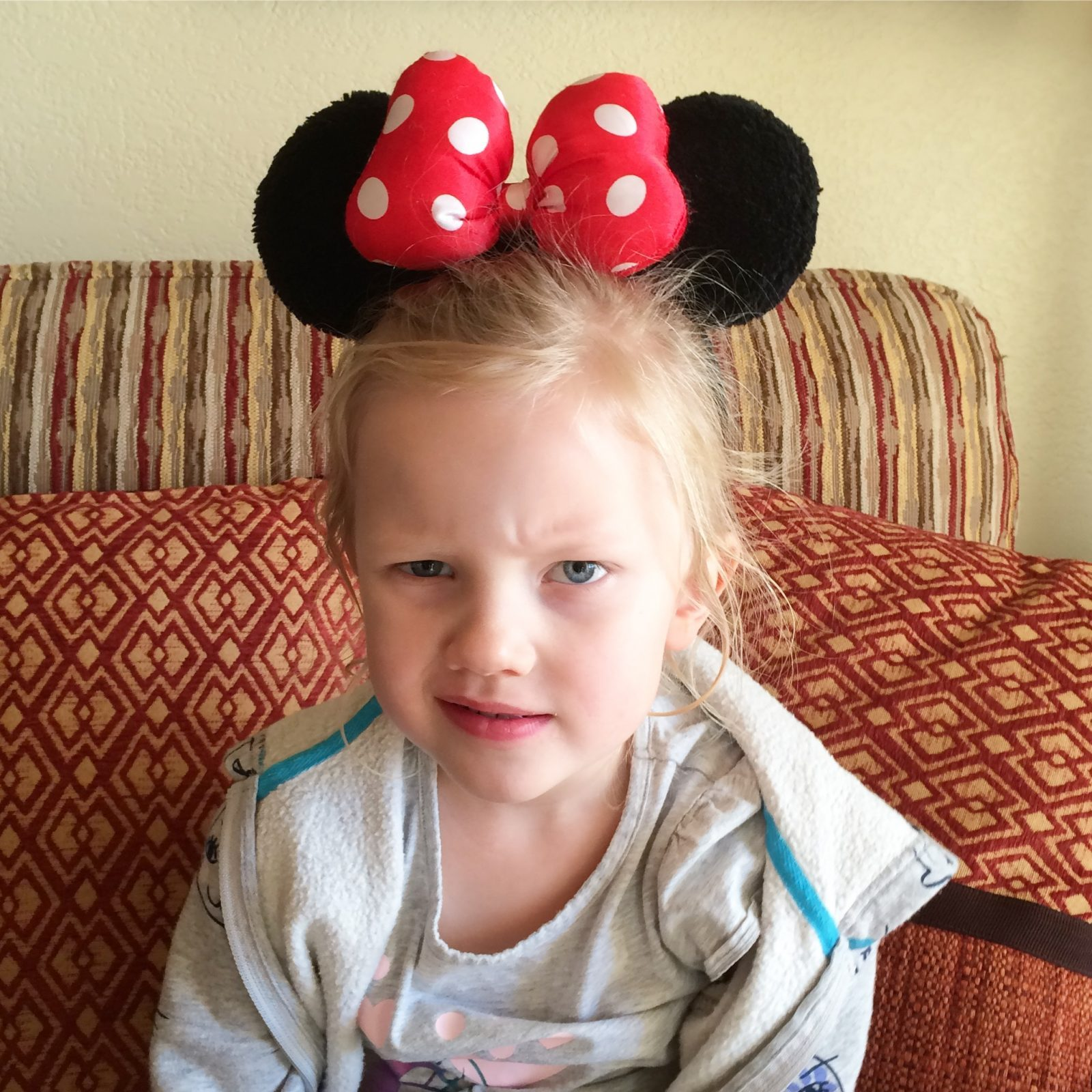 little girl with minnie mouse ears