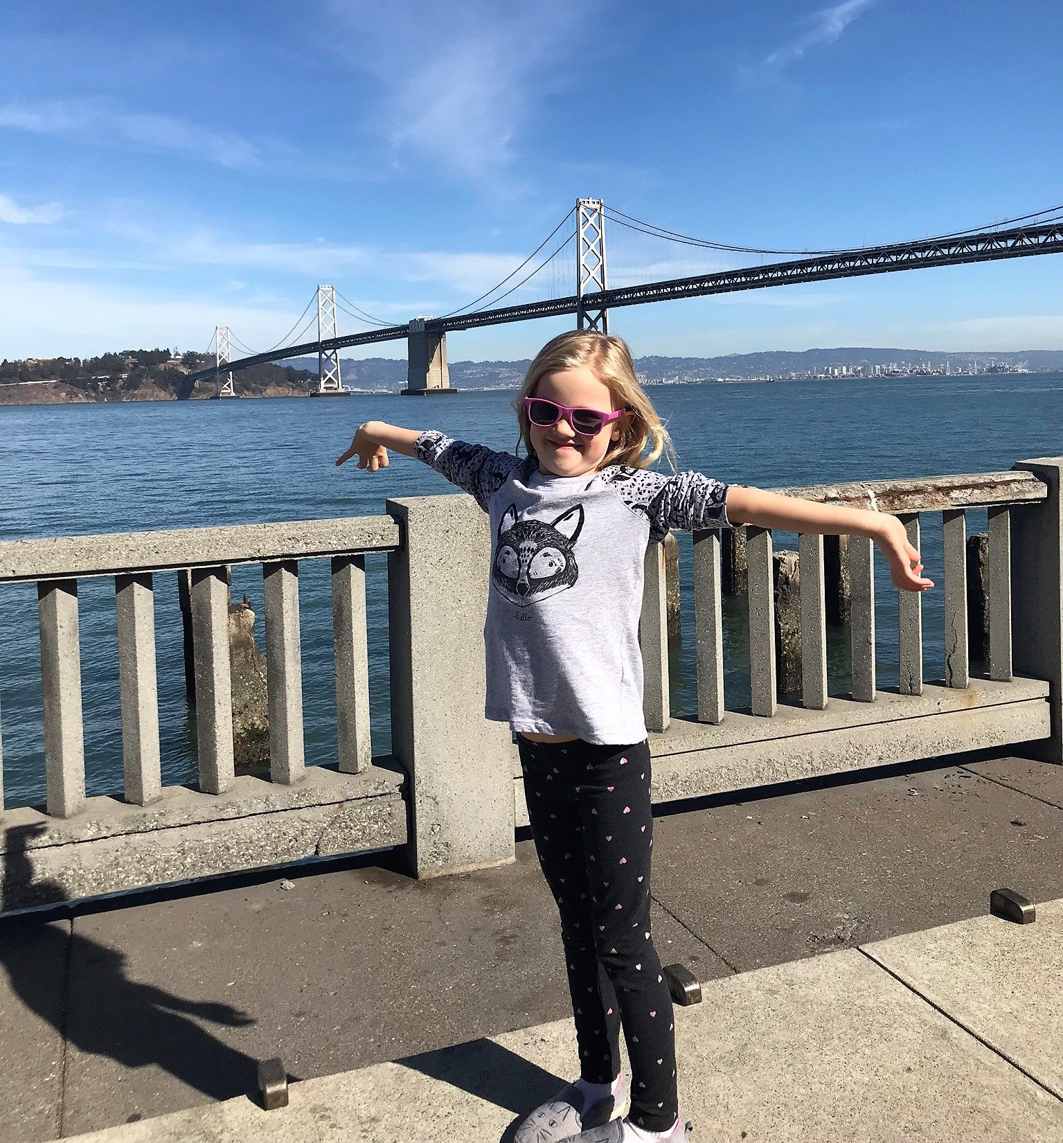 little girl in front of the golden gate bridge