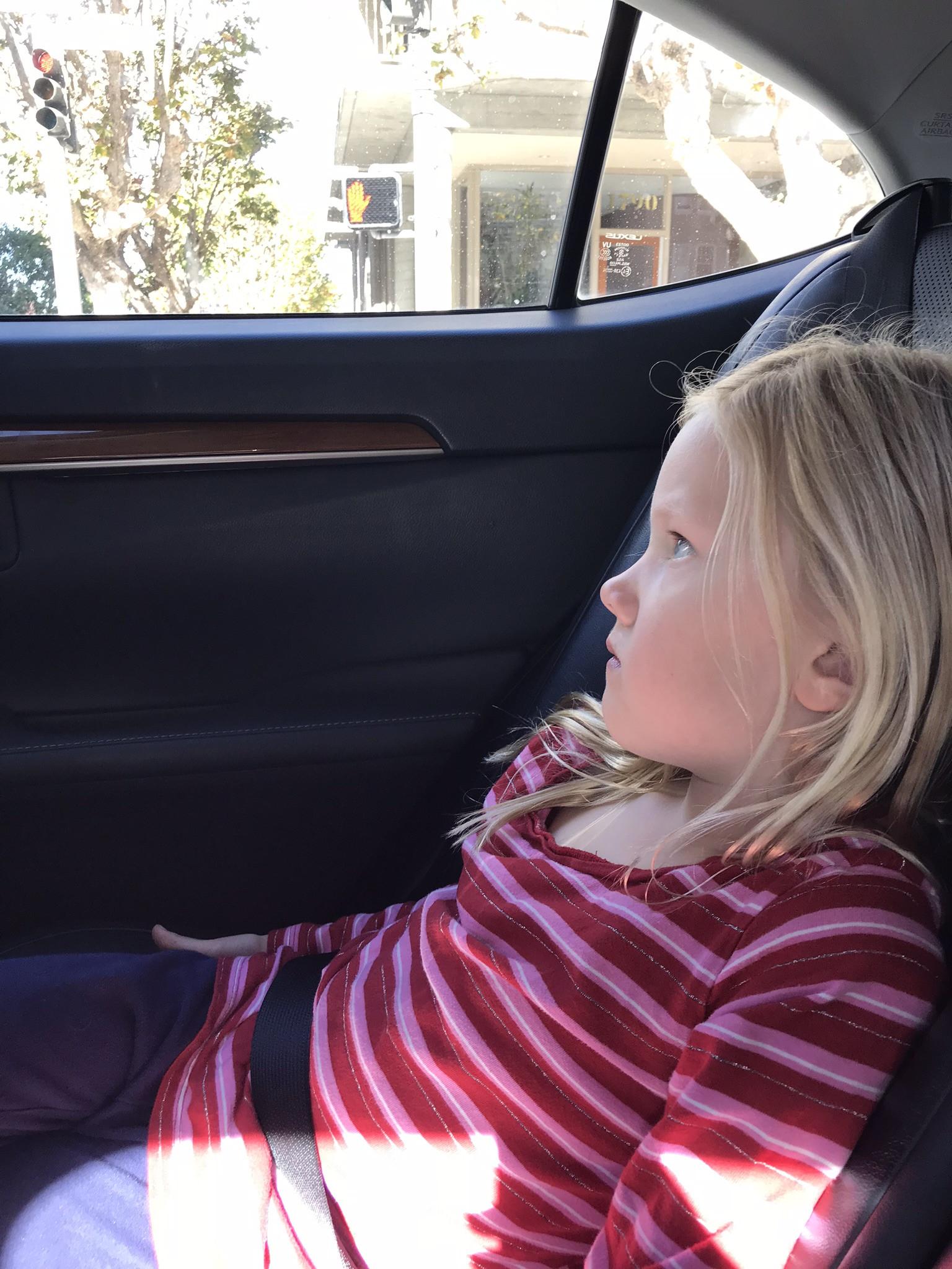 little girl in an uber ride