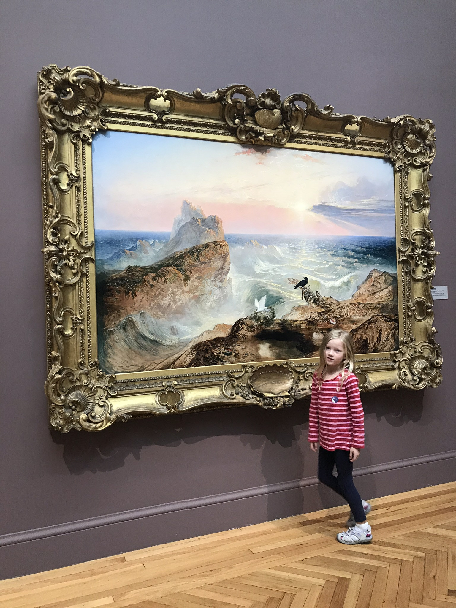 little girl in front of painting