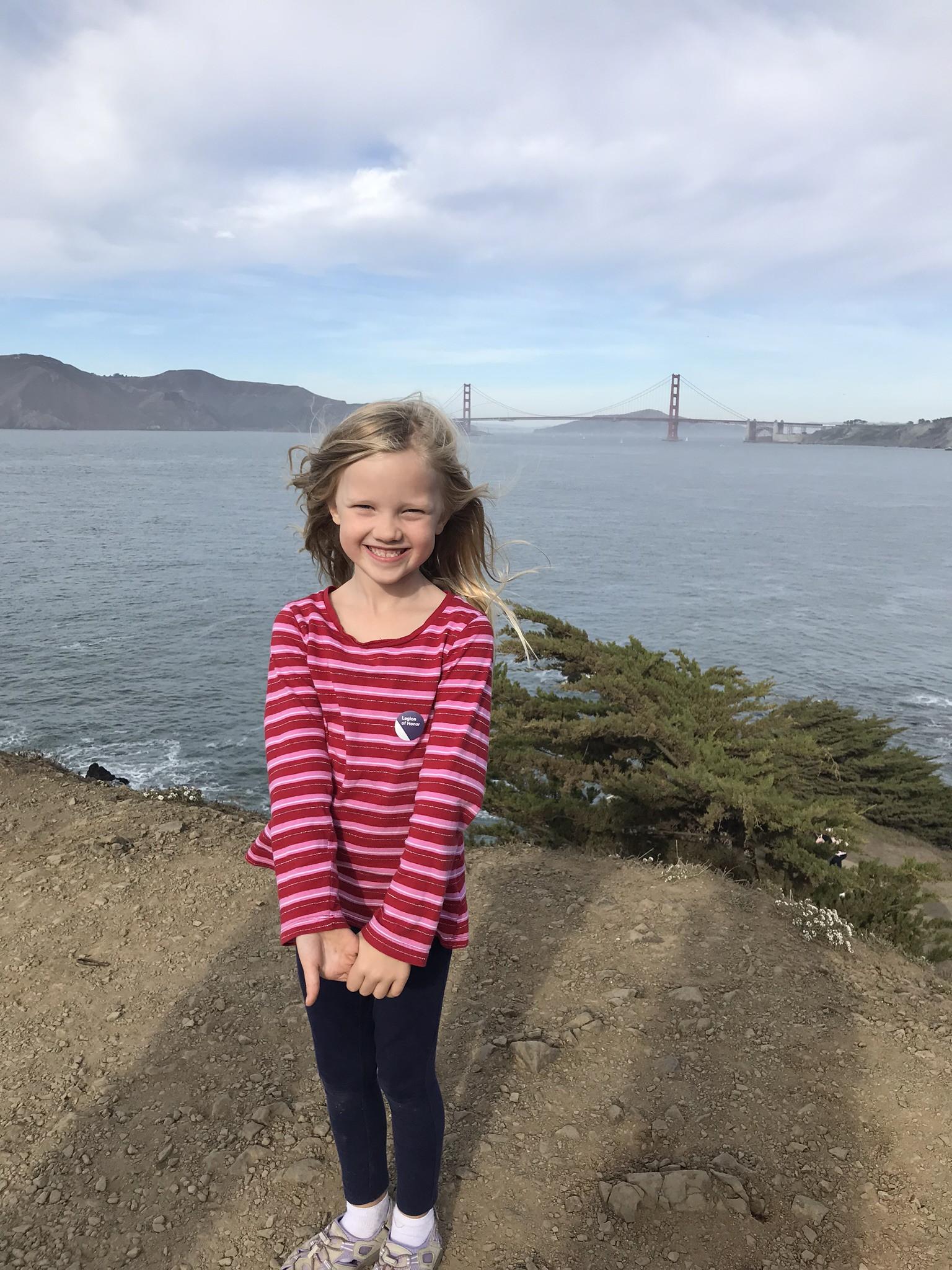 little girl with golden gate bridge in background