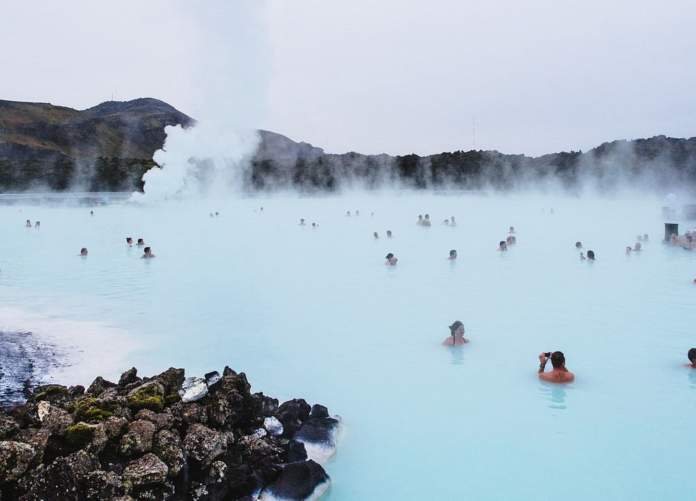 people soaking in the blue lagoon