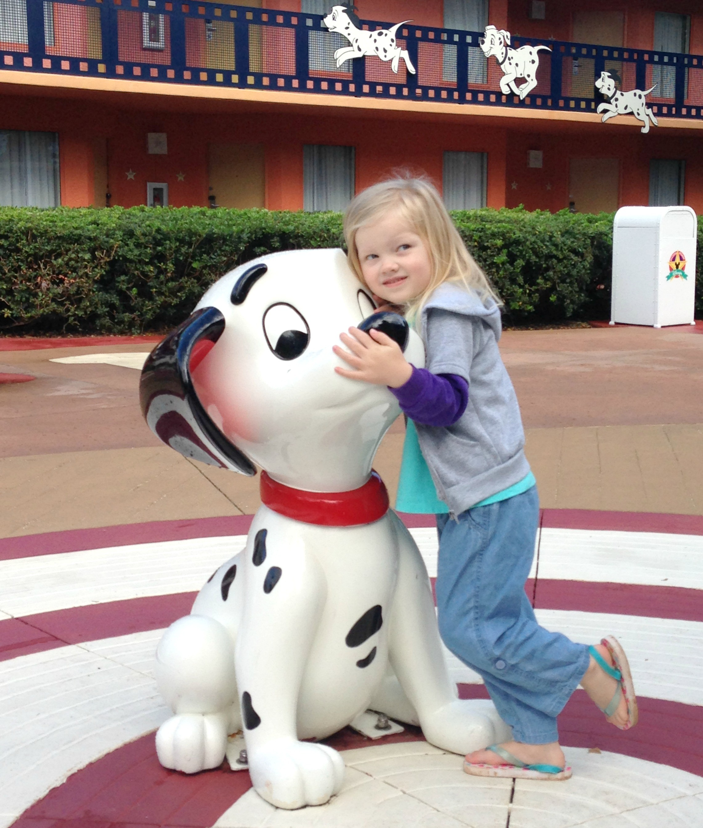 little girl with 101 dalmatians puppy statue