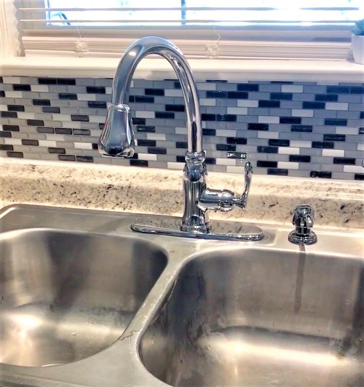 kitchen sink with backsplash