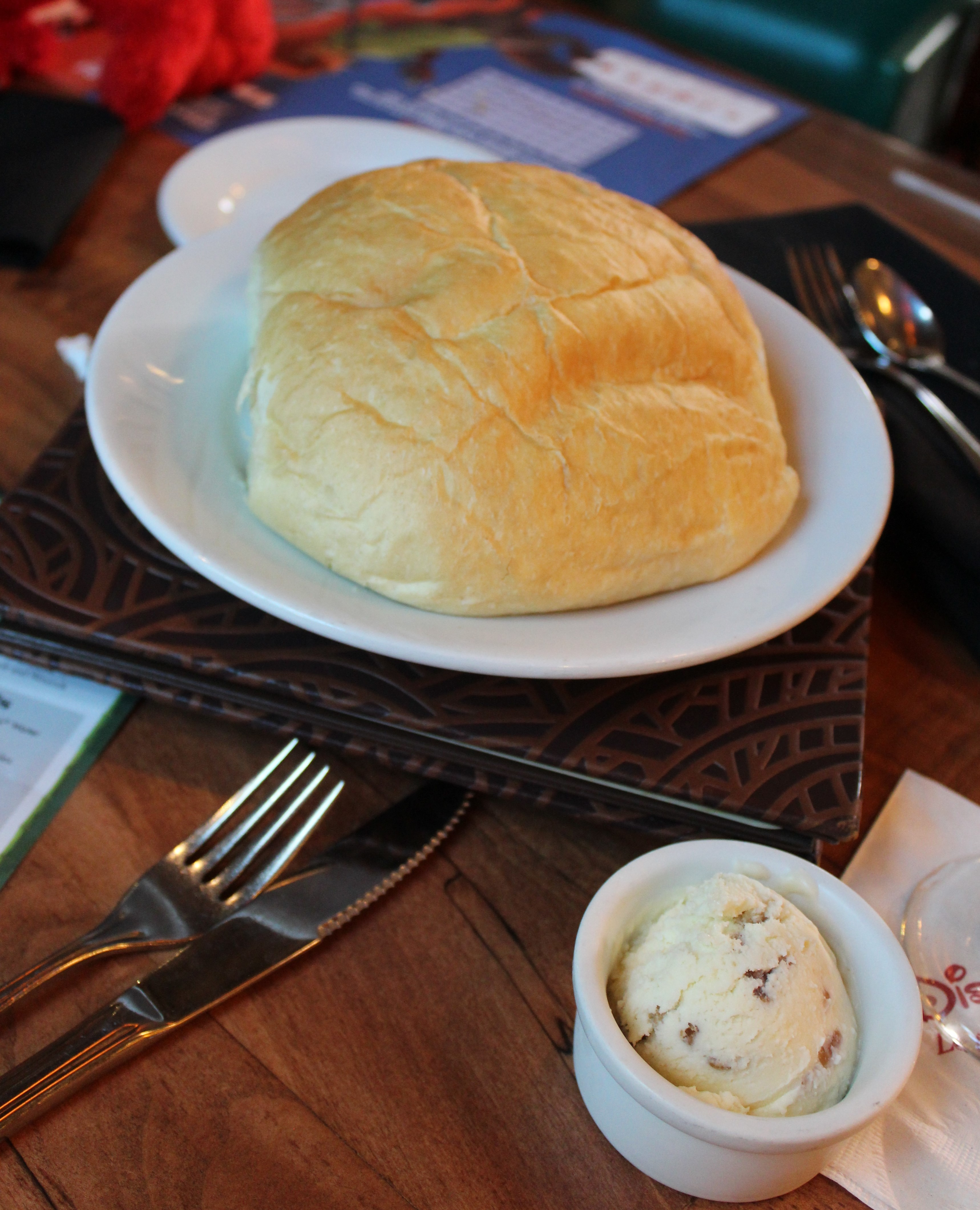 Bread roll with butter on the side