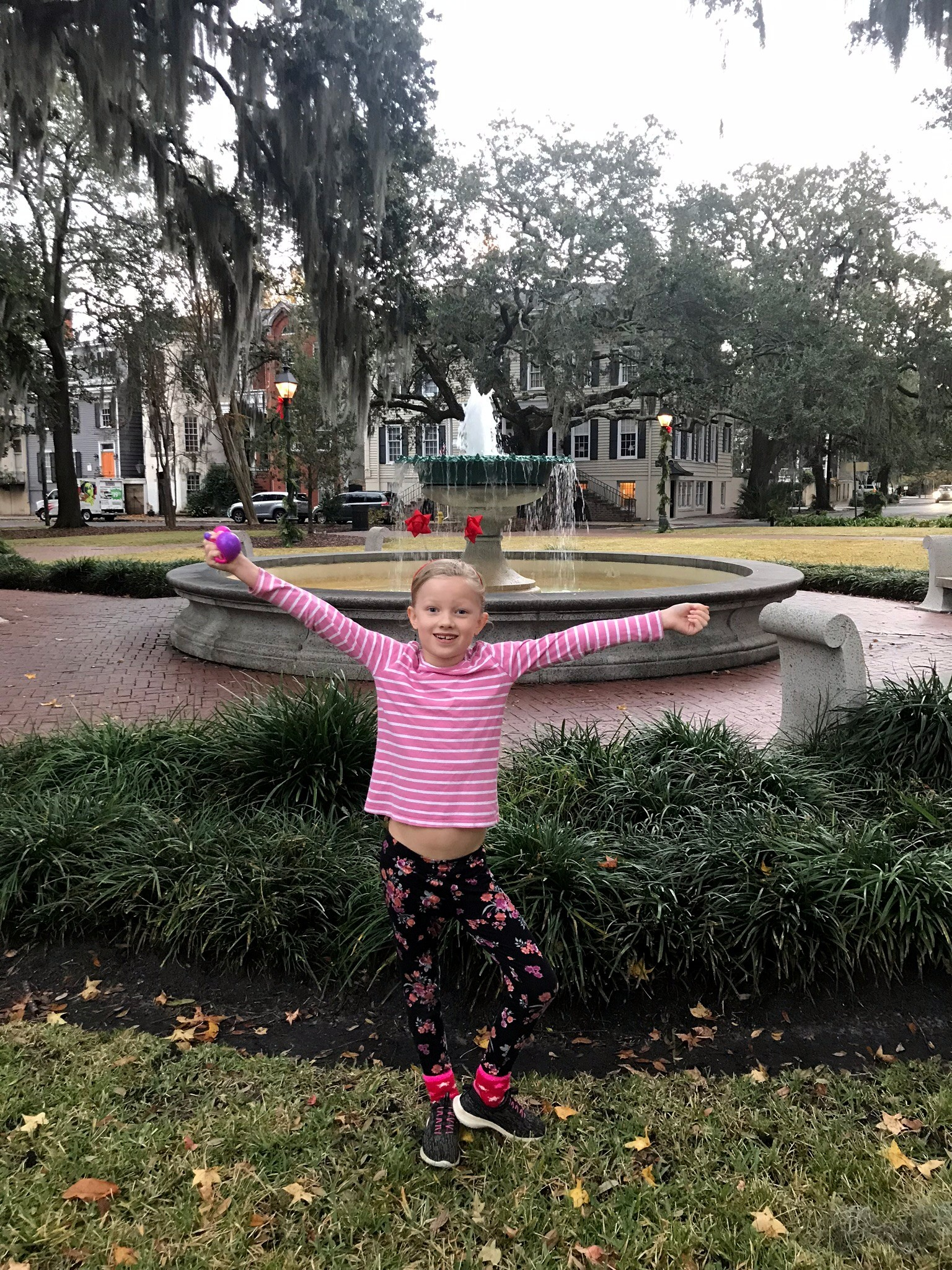 girl in front of fountain in Savannah