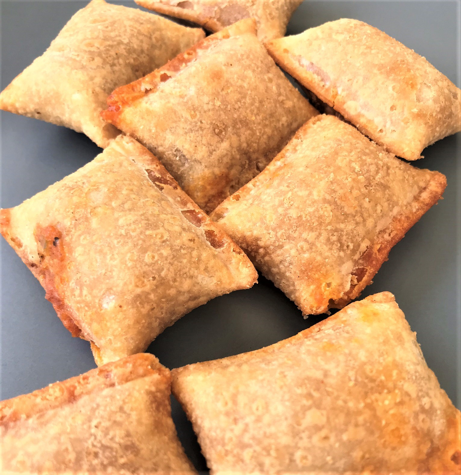 air fryer pizza rolls on a plate