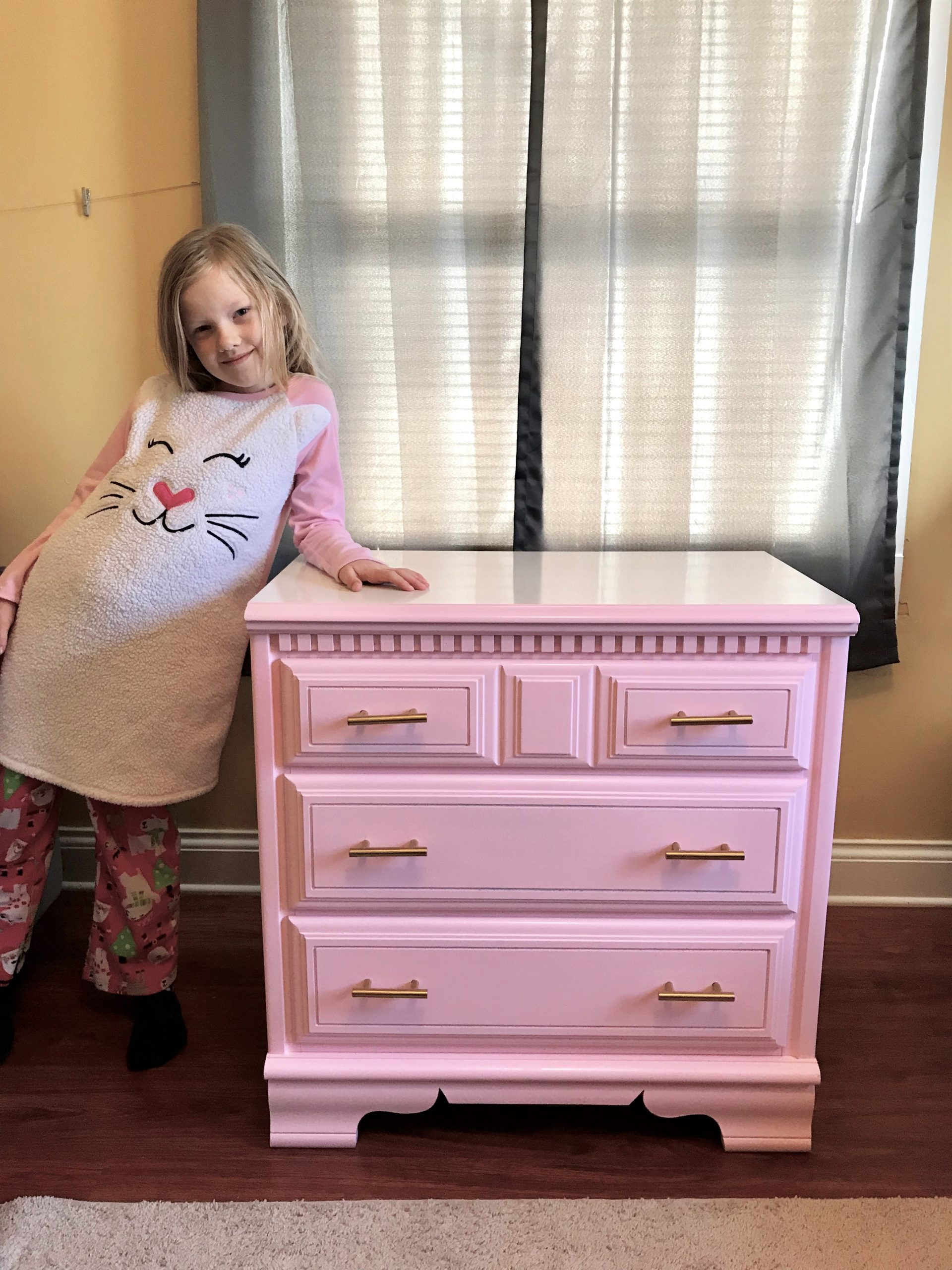 little girl beside her new finished chest of drawers