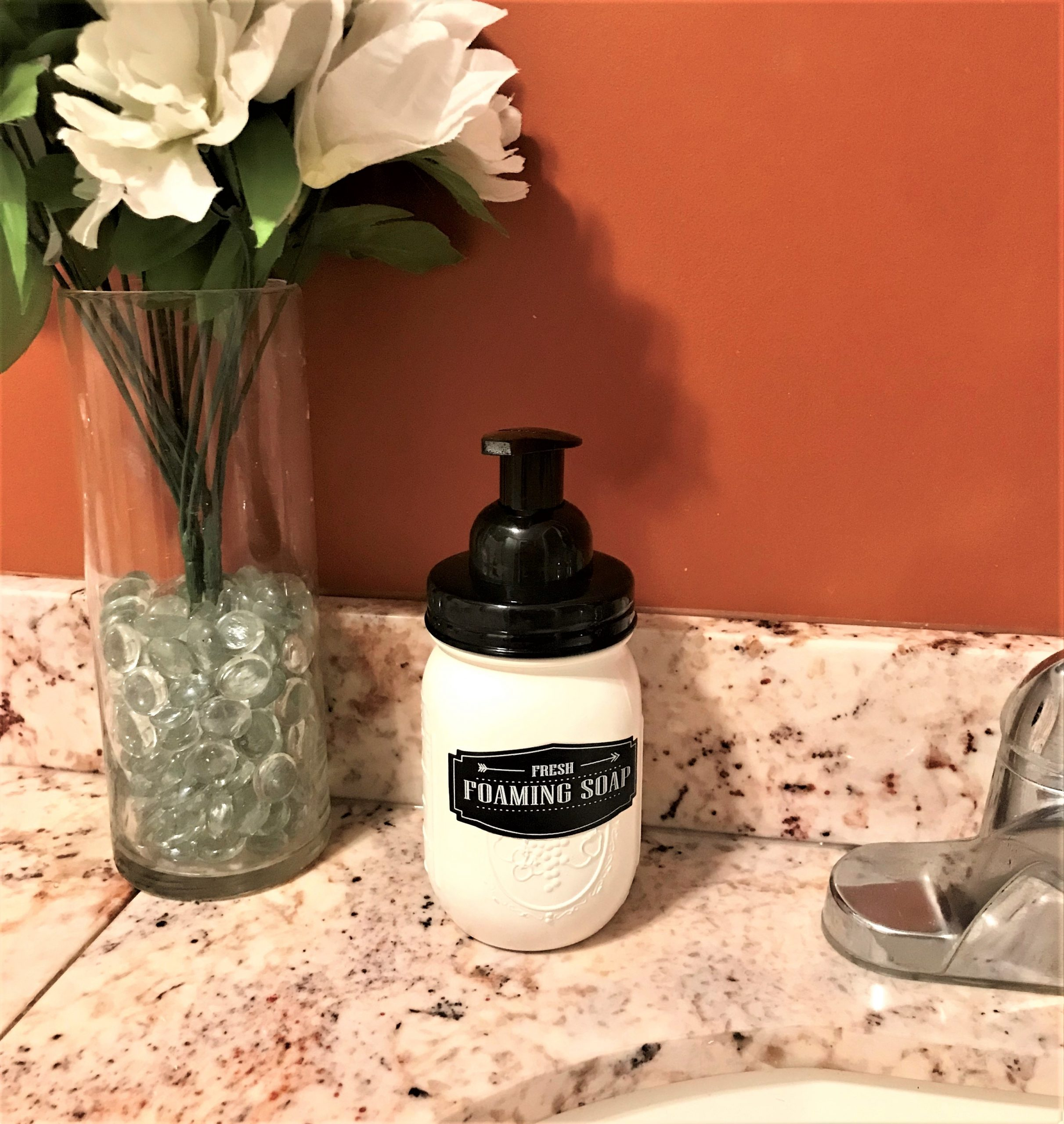 soap pump next to the bathroom sink