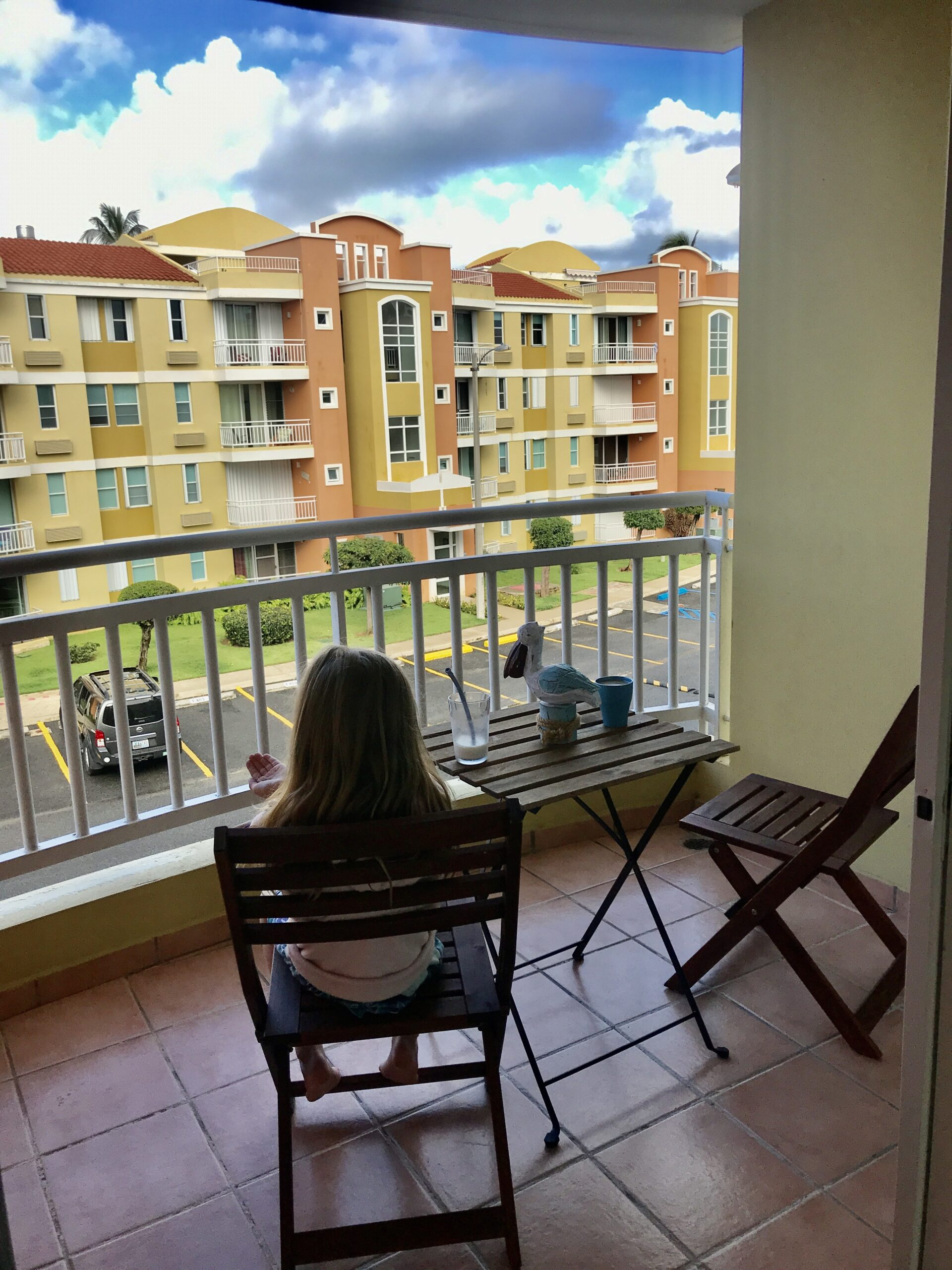 girl on chair on patio