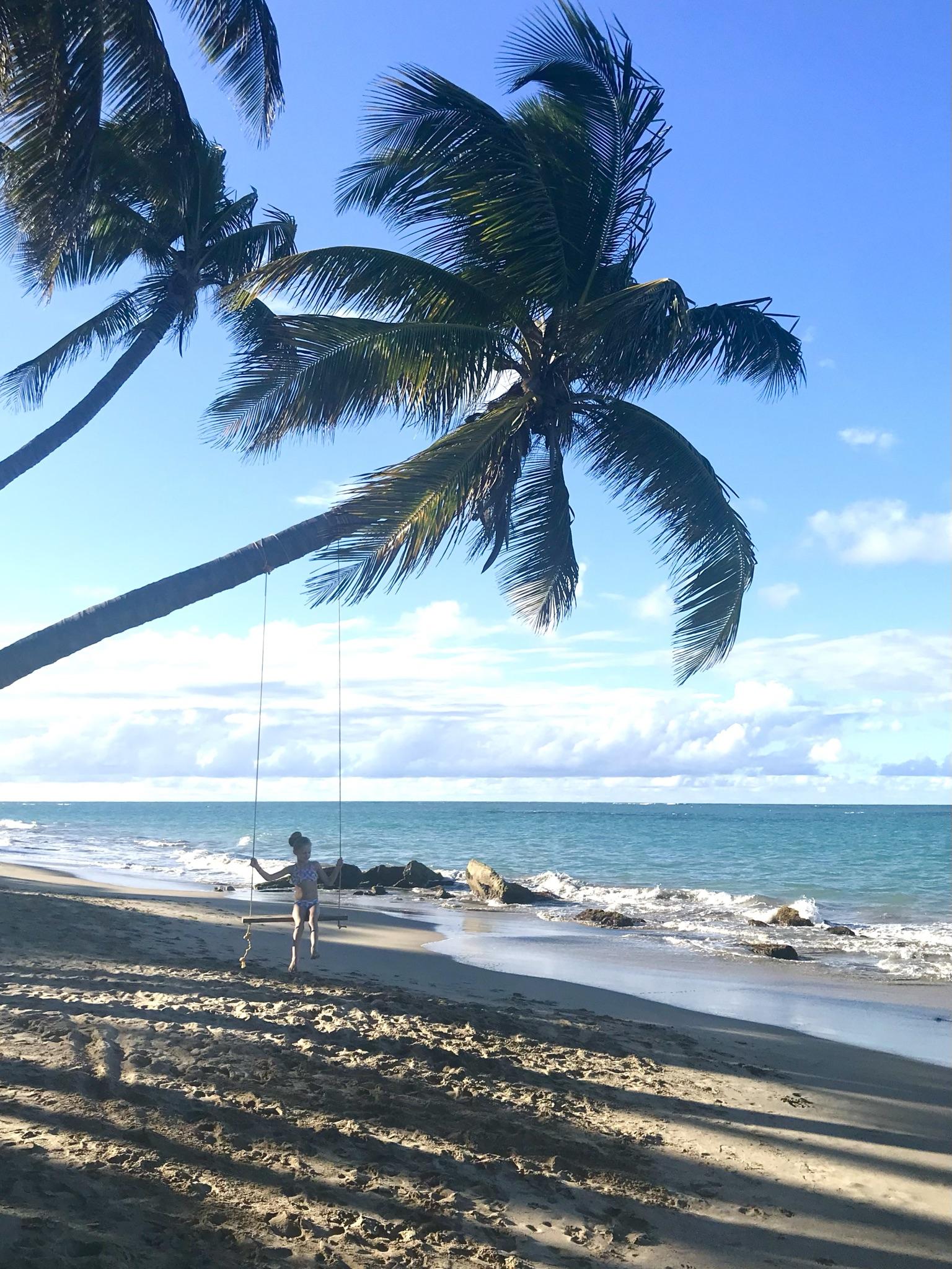 girl on swing on beach in puerto rico