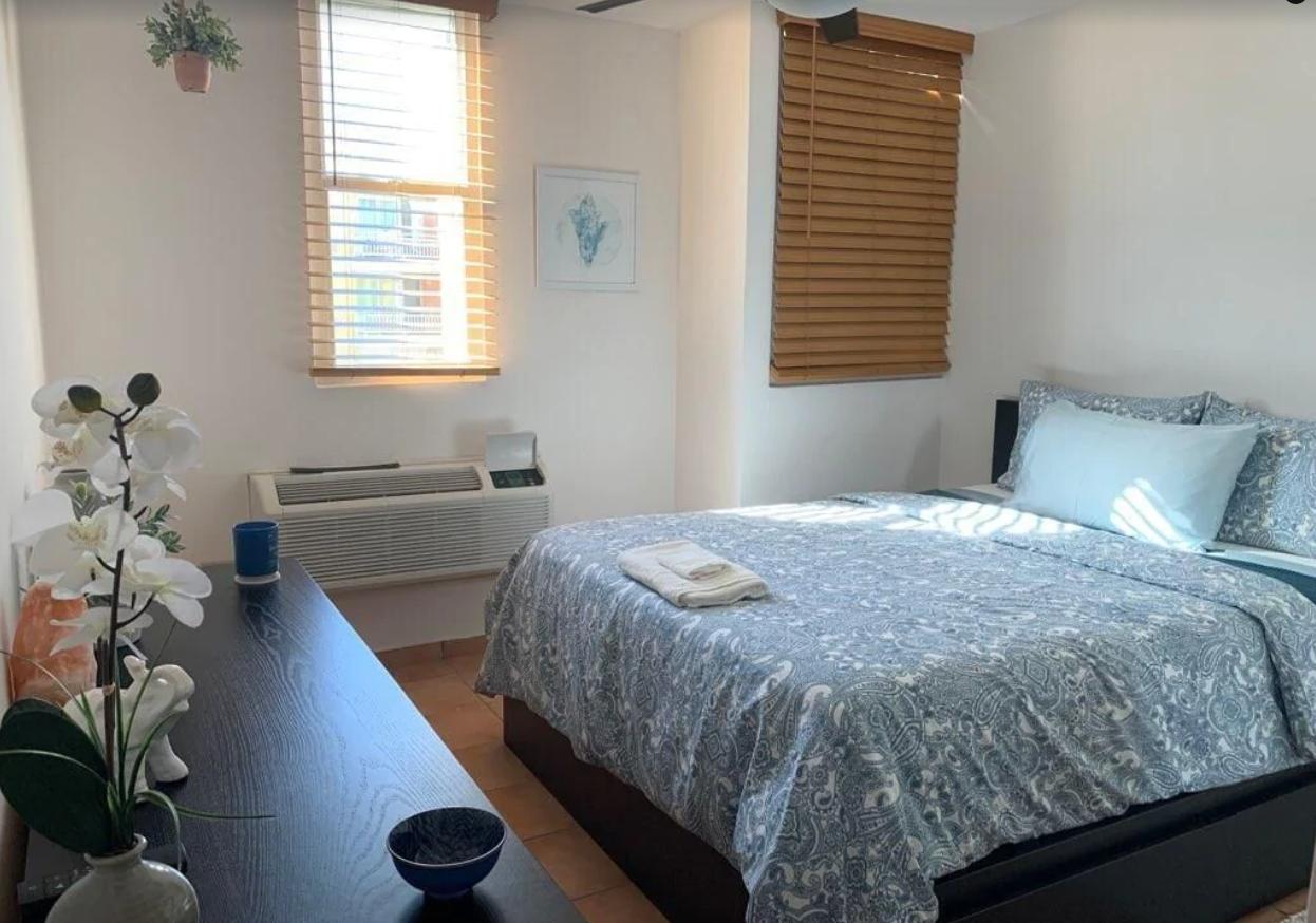 bedroom with one queen bed